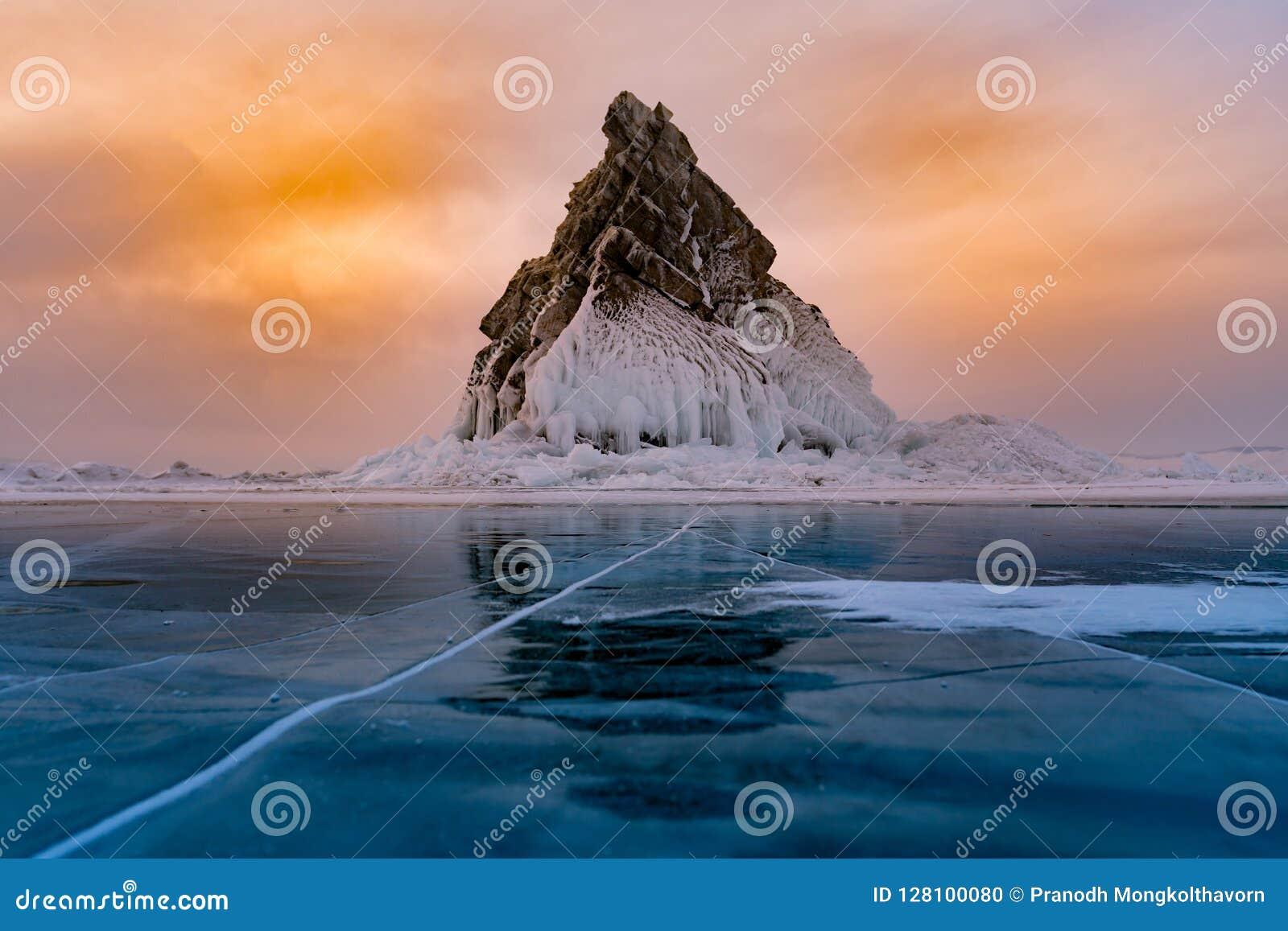 Rock on freeze water lake, Baikal Russia winter season