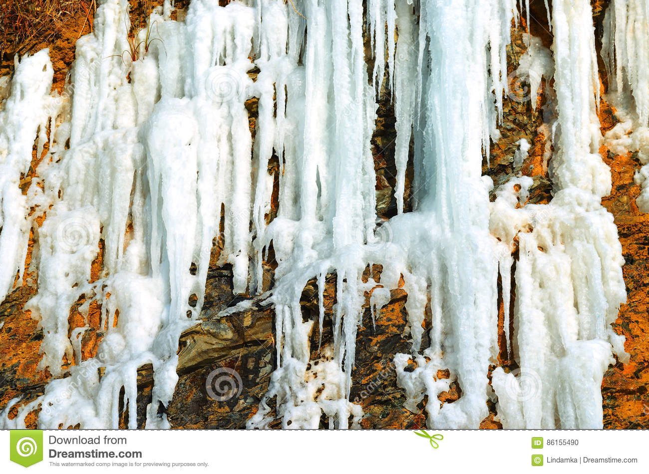 Rock with a frozen waterfall