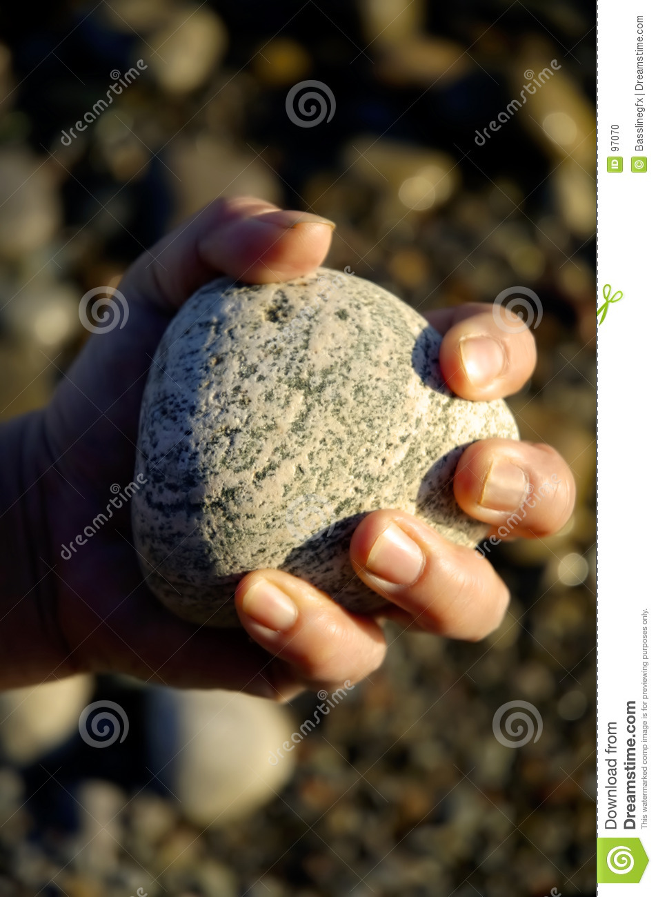 rock in hand closed stock photo
