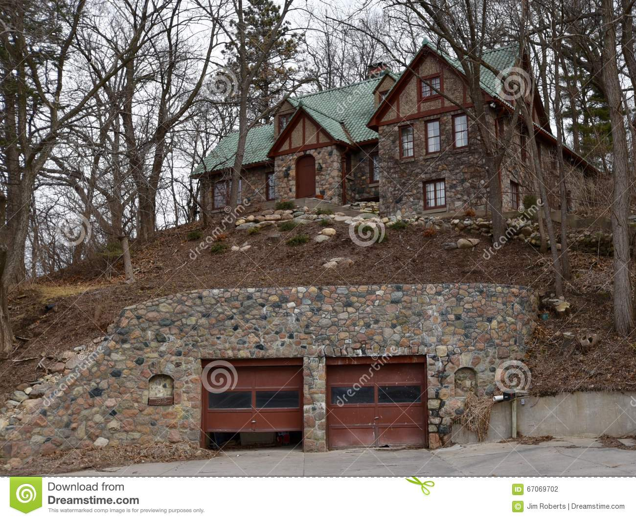 Rock house on a hill editorial photography image 67069702 for House on top of garage