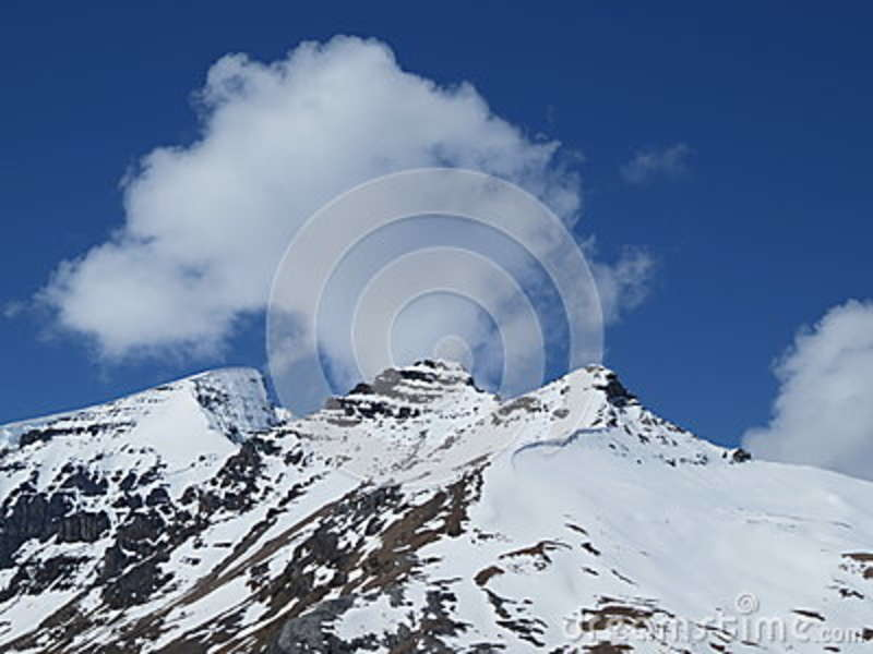 Download Rock Mountain Covered With Snow Under Blue Sky Stock Photo - Image of mountain, cold: 83016552