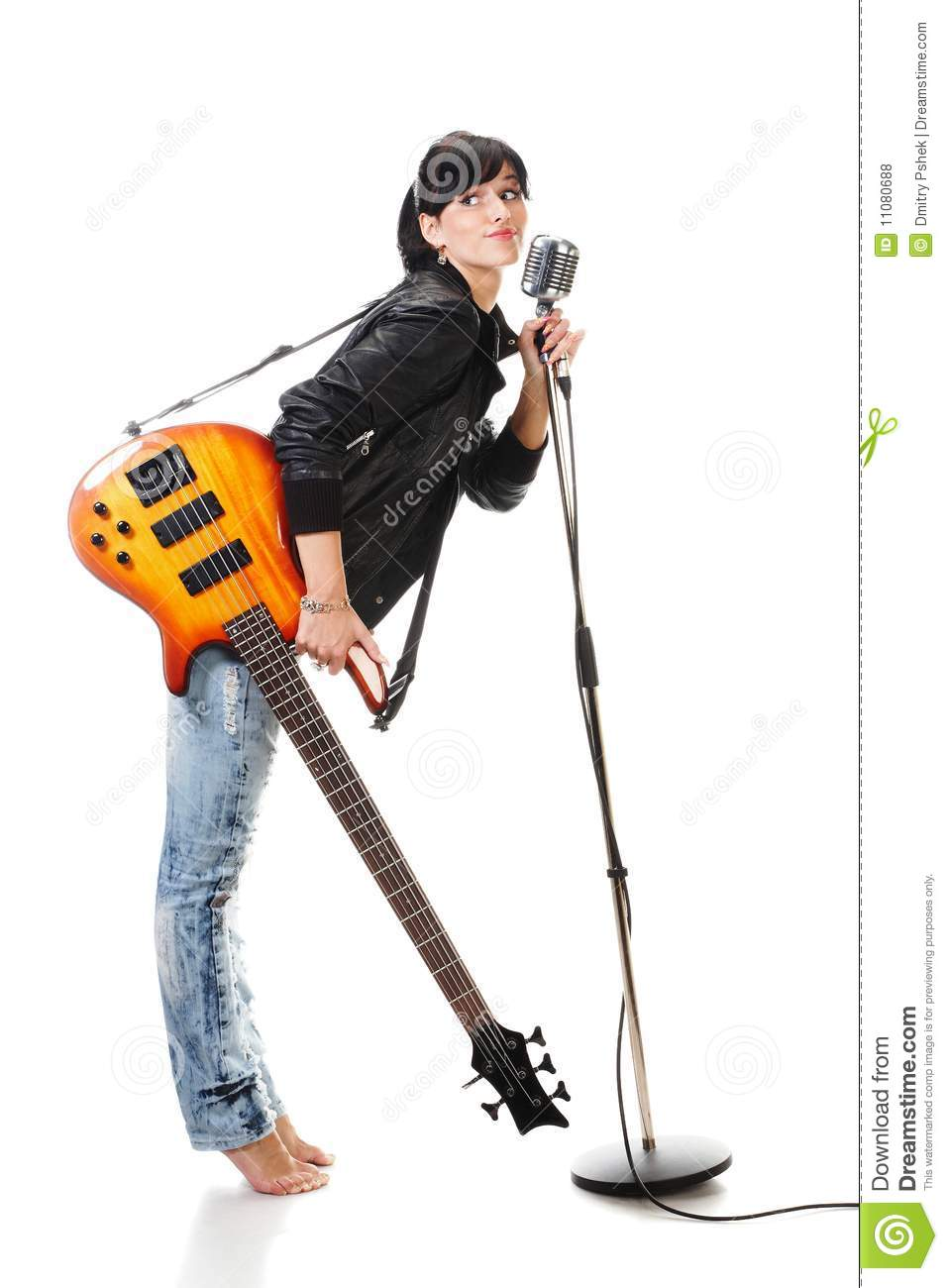 Rock-n-roll girl holding a guitar singing