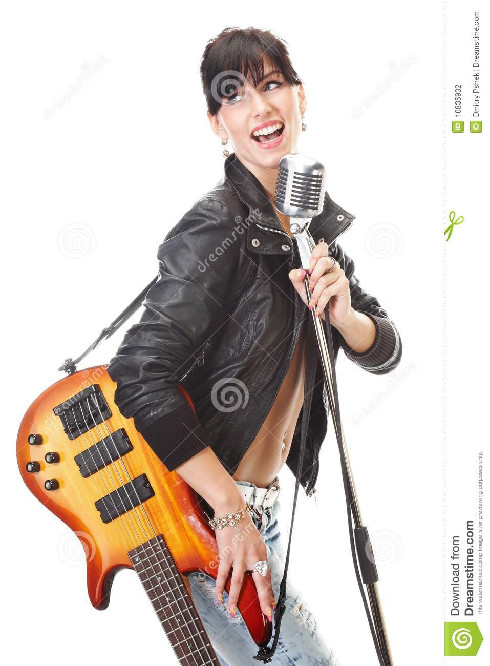 Rock-n-roll girl holding a guitar singing into ret