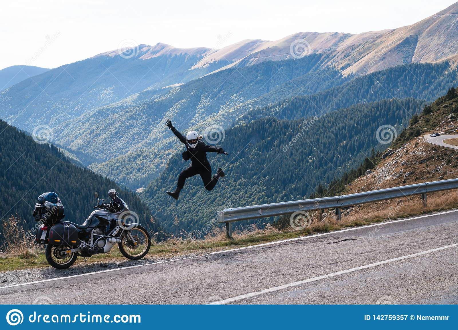 Rock n roll jump from happiness. motorcycle adventure mountain, enduro, off road, beautiful view, danger road in mountains,