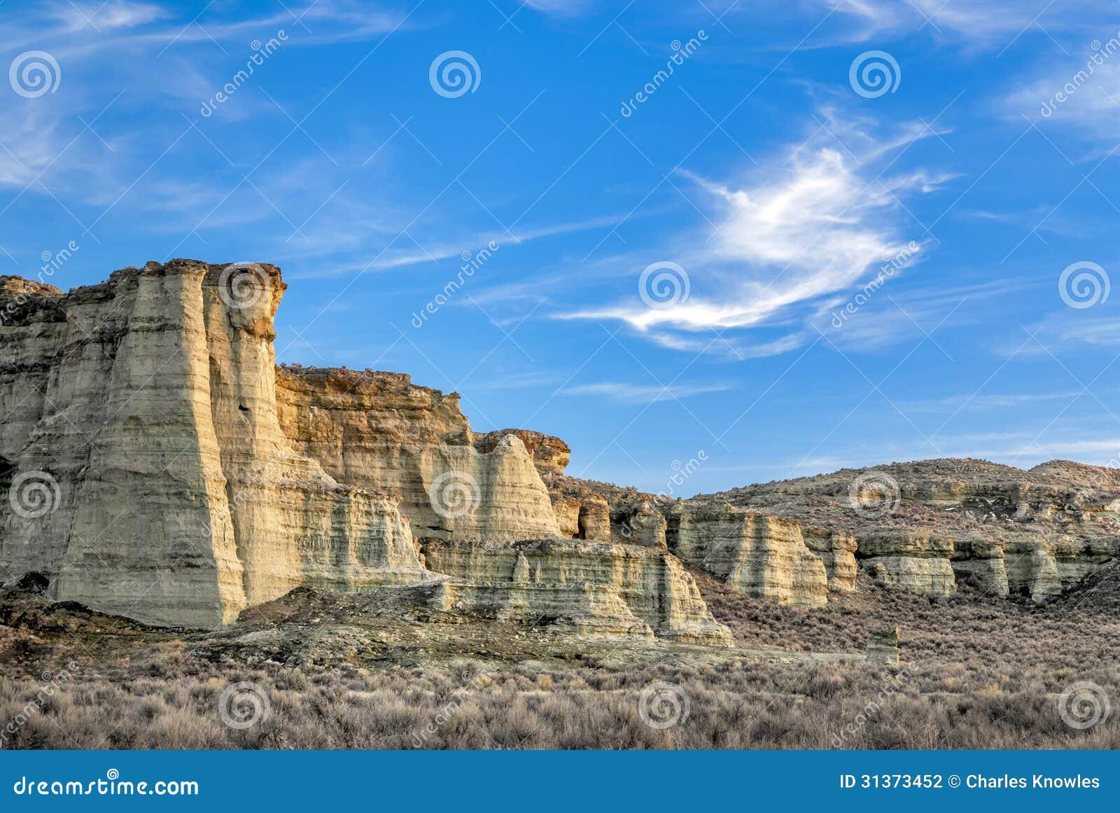 Desert Rock Pillars : Rock pillars in the western desert at sunset stock
