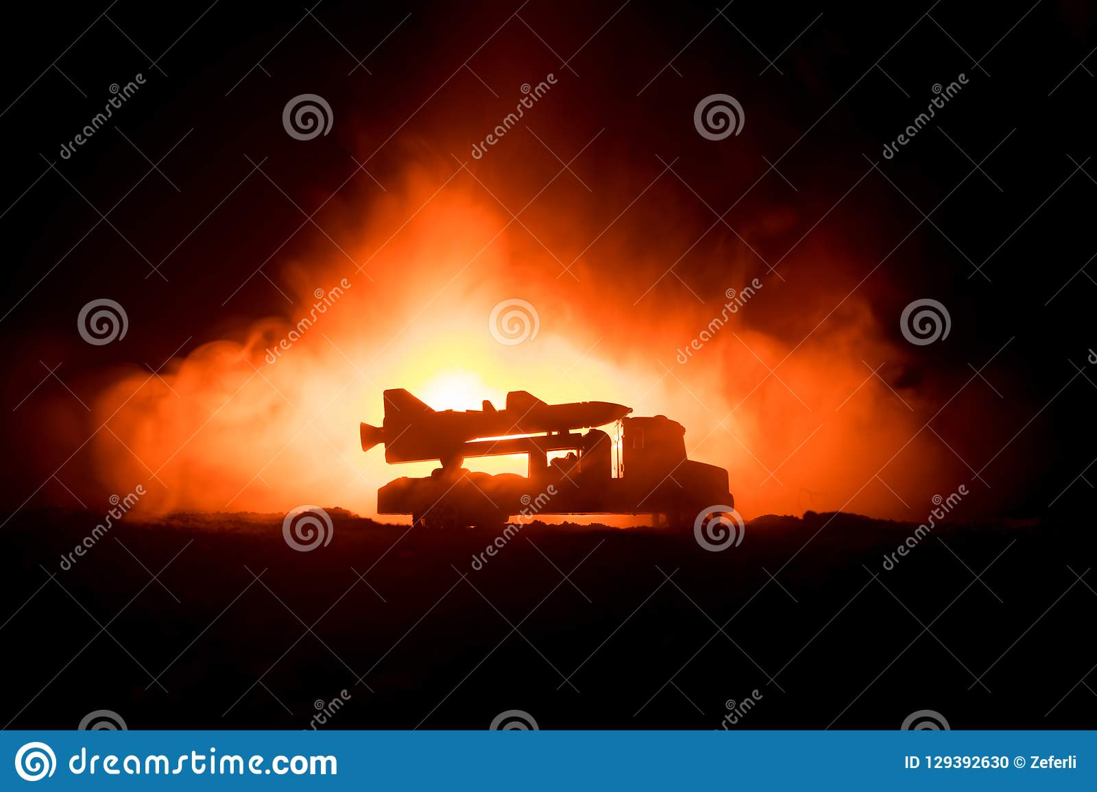 Rocket launch with fire clouds. Battle scene with rocket Missiles with Warhead Aimed at Gloomy Sky at night. Rocket vehicle on War