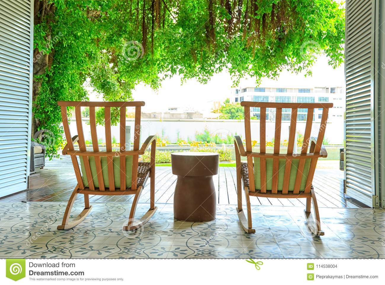 Wondrous Rocking Chair In The Terrace On The Garden Stock Photo Squirreltailoven Fun Painted Chair Ideas Images Squirreltailovenorg