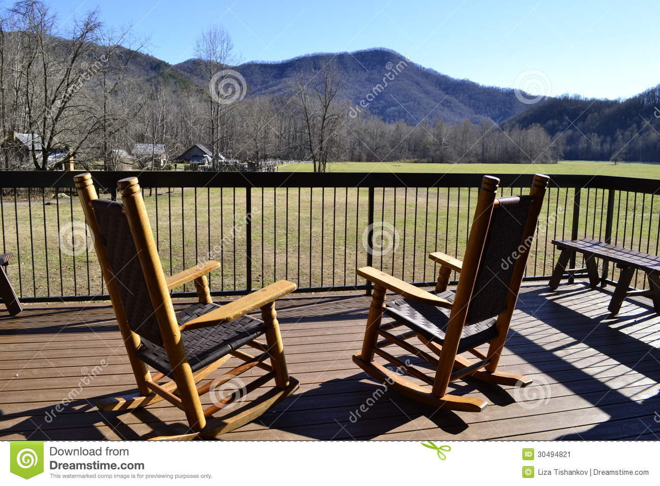 Two wooden rocking chairs from rear on porch overlooking Great Smoky ...