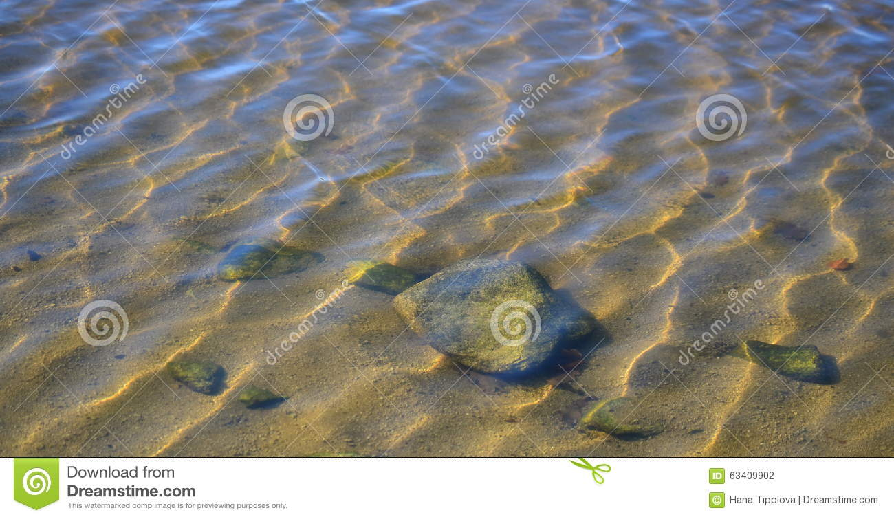 Rocks beneath the water surface