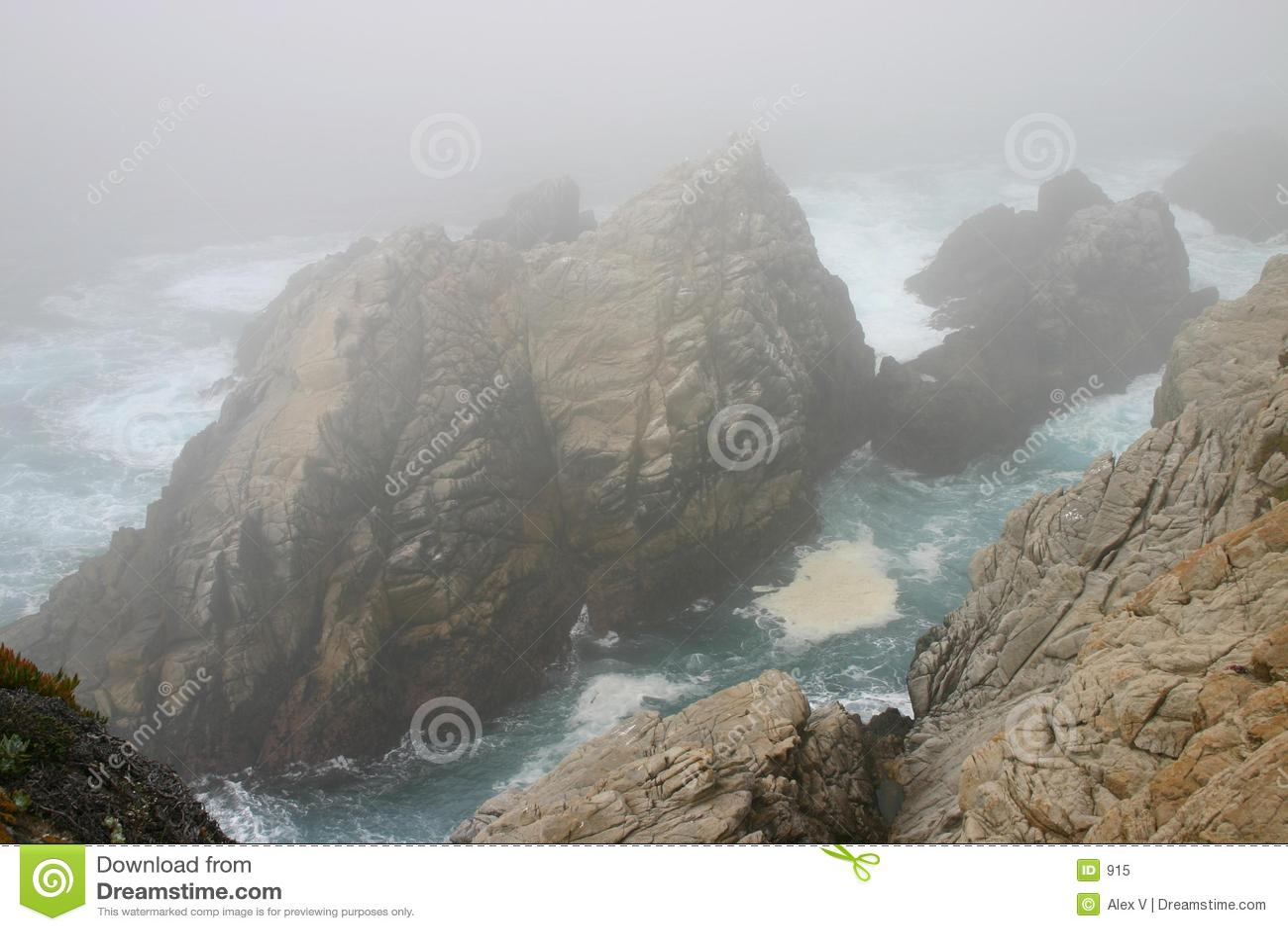 Rocks, fog, and the blue ocean