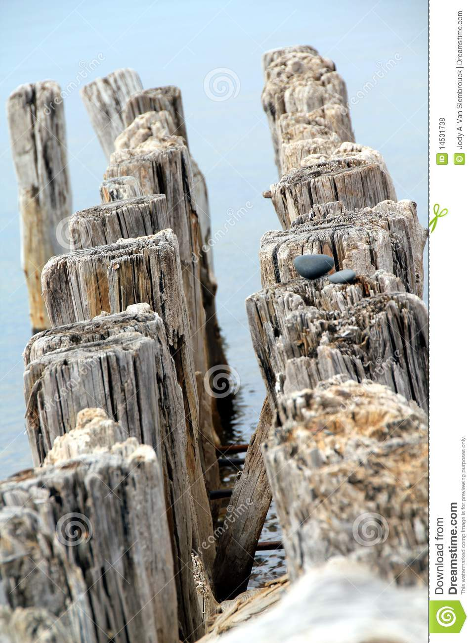 Rocks and pilings on lake superior michigan royalty free for Dock pilings cost
