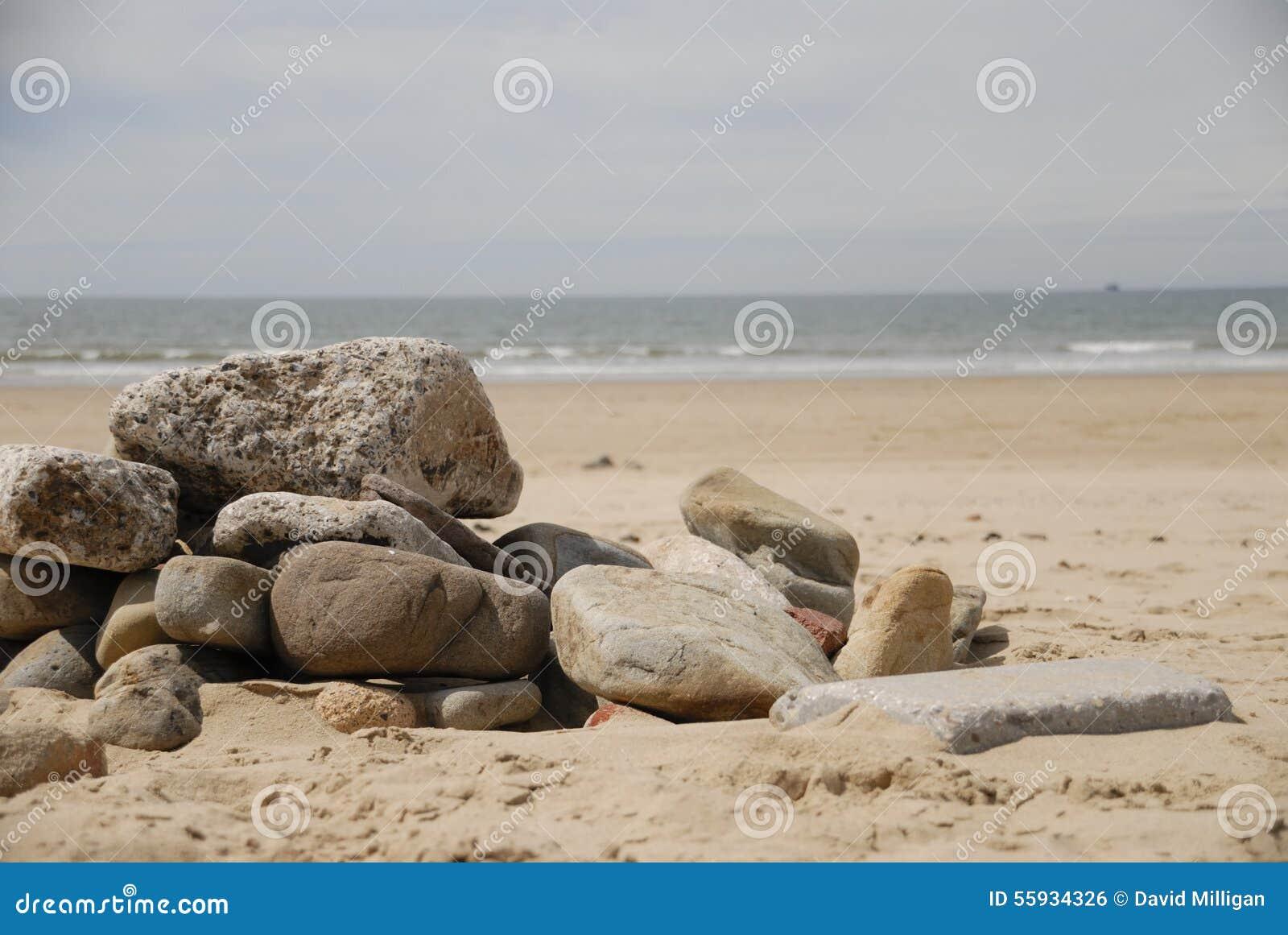 Rocks on sand at beach