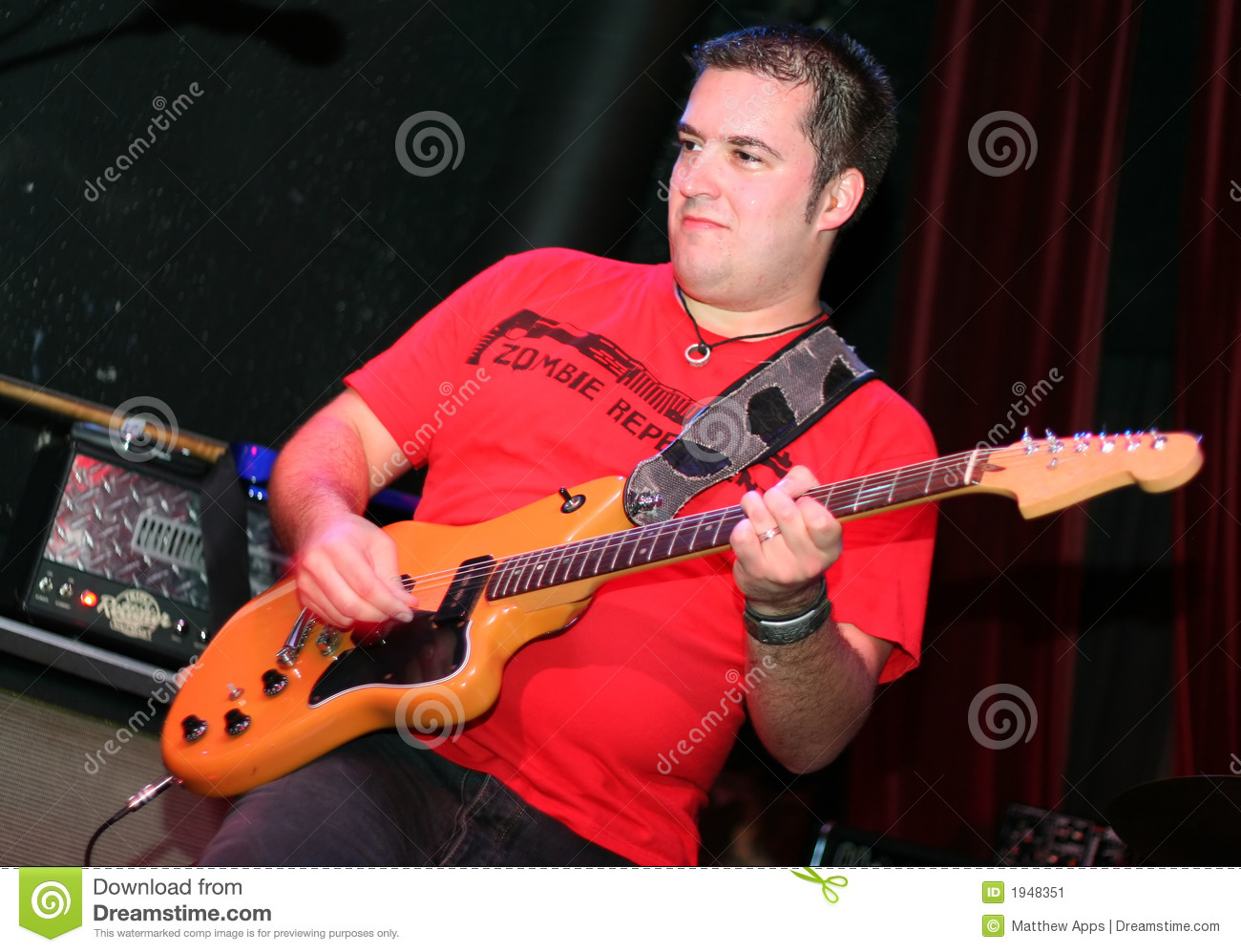 Rockstar Playing Guitar On Stage Stock Image