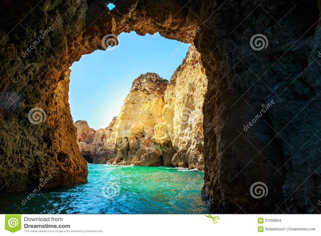 Picturesque rocky grotto in the sea against blue sky, Portugal.
