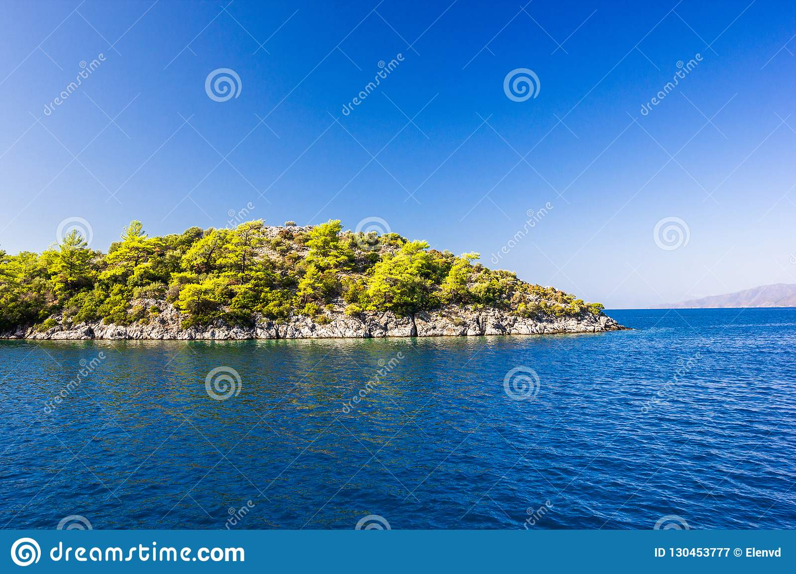 Rocky island in the Aegean sea on a clear day