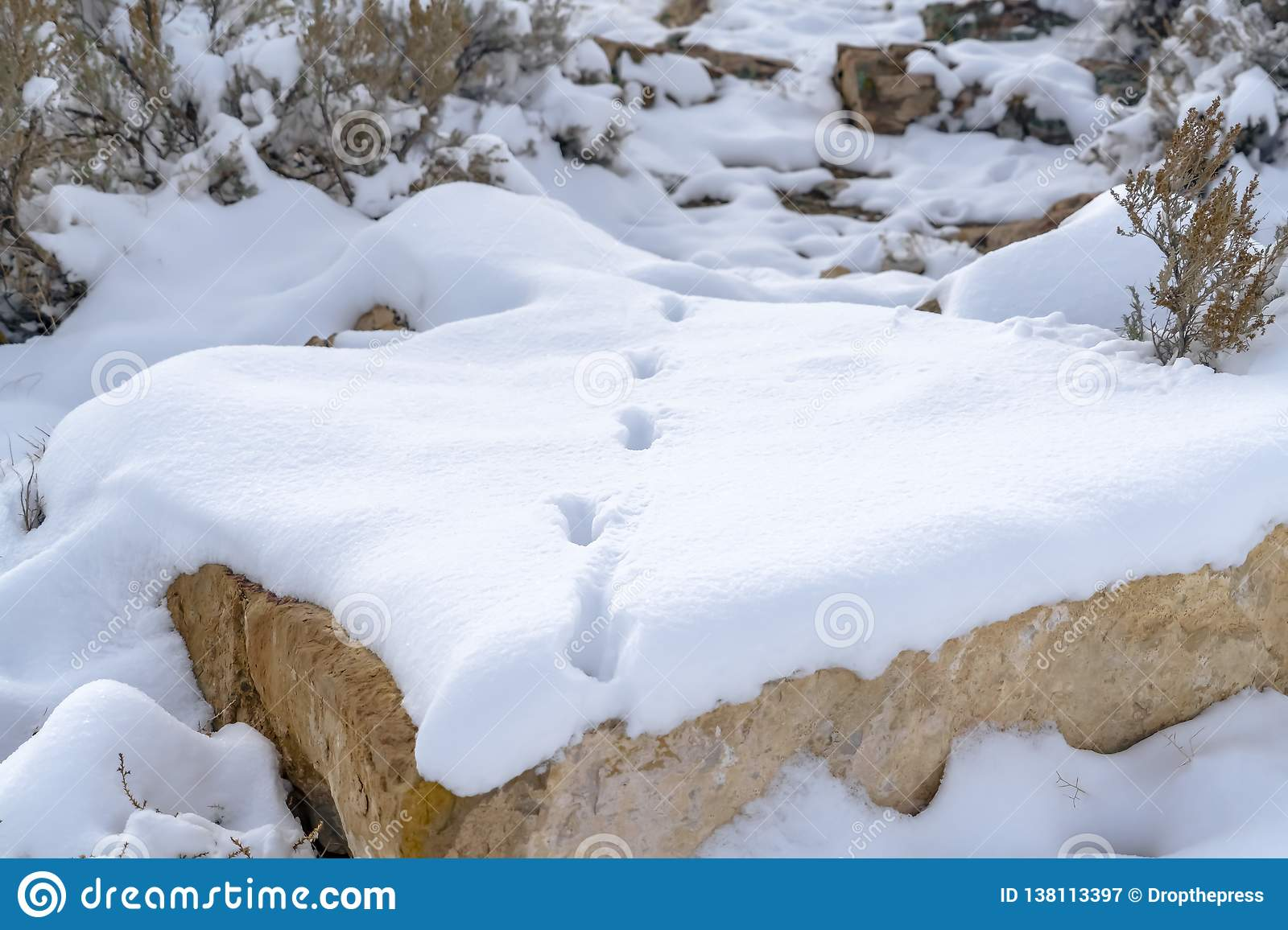 Rocky landscape with footsteps on the snow