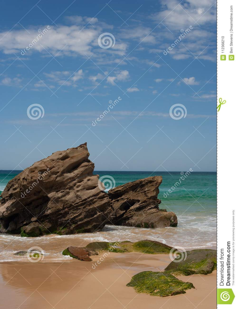 Rocky outcrop at the beach on sunny summers day