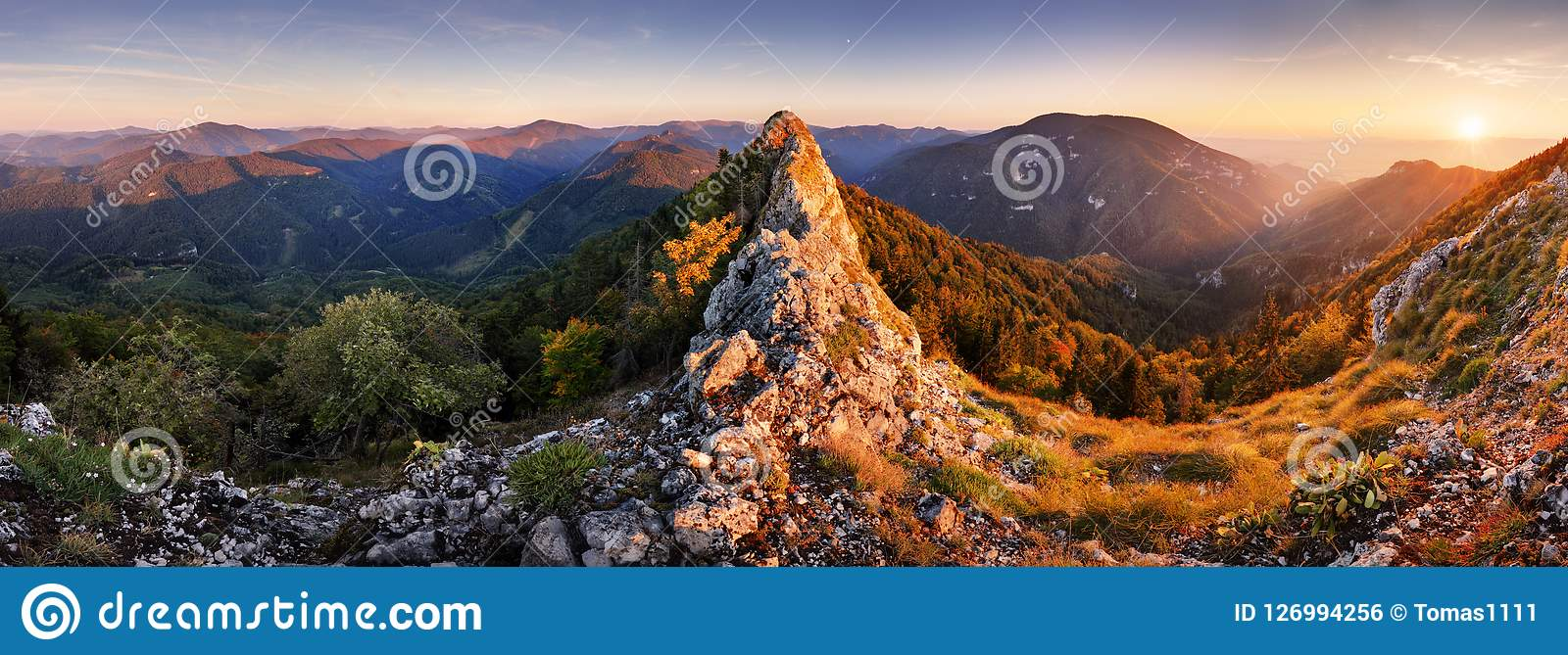 Rocky Panorama of sunset in mountain valley landscape