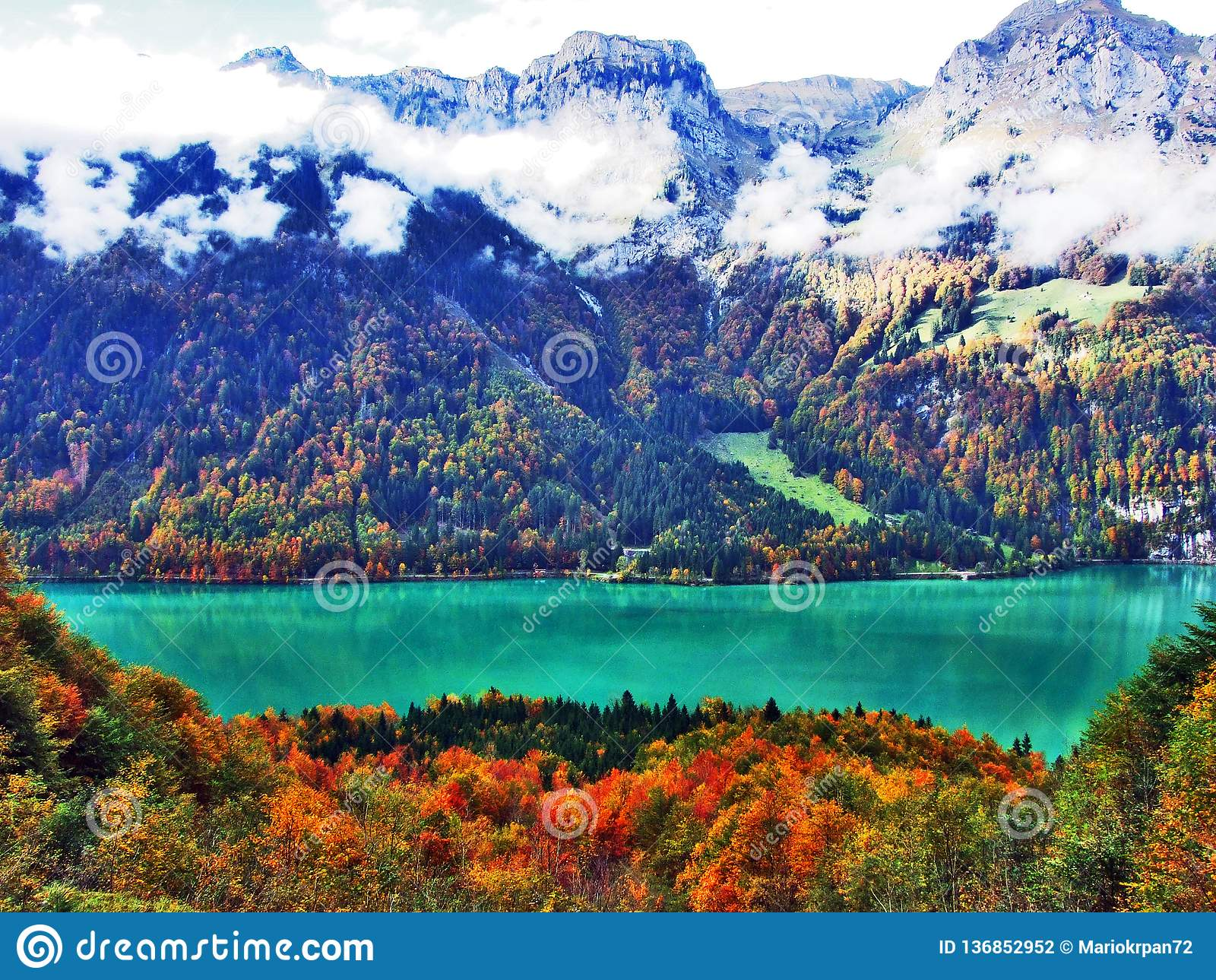 Rocky peak Mattlistock in the Glarus Alps mountain range and above Lake Klontalersee