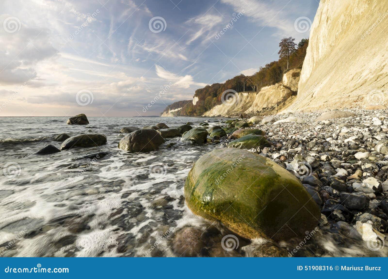 Rocky sea coast, in the light of the rising sun