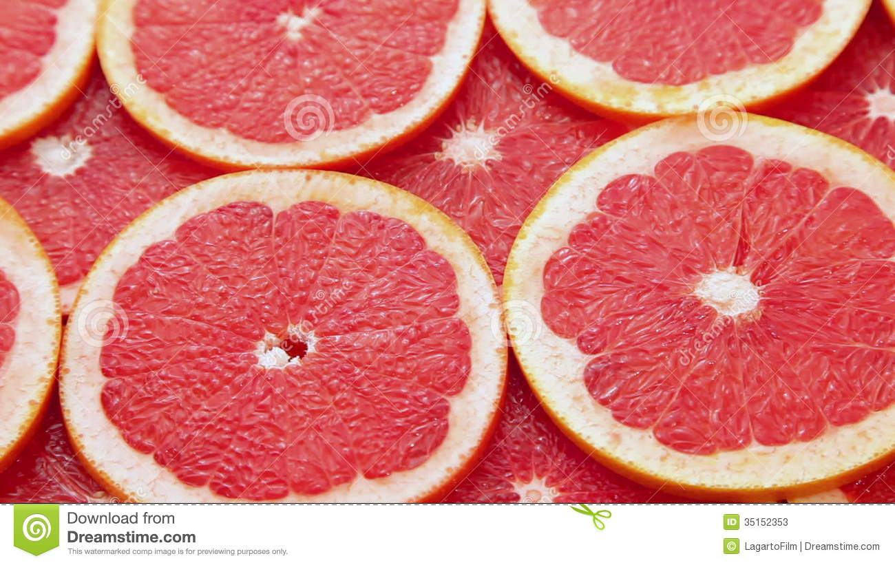 Rode grapefruit met oranje achtergrond stock footage   video: 35152353