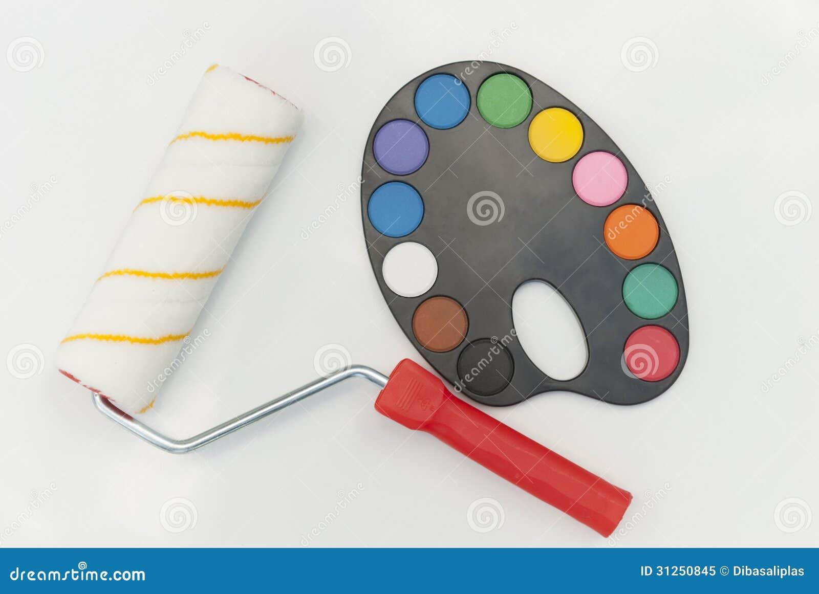 Rodillo para pintar y paleta con las pinturas de la - Paleta de pinturas ...