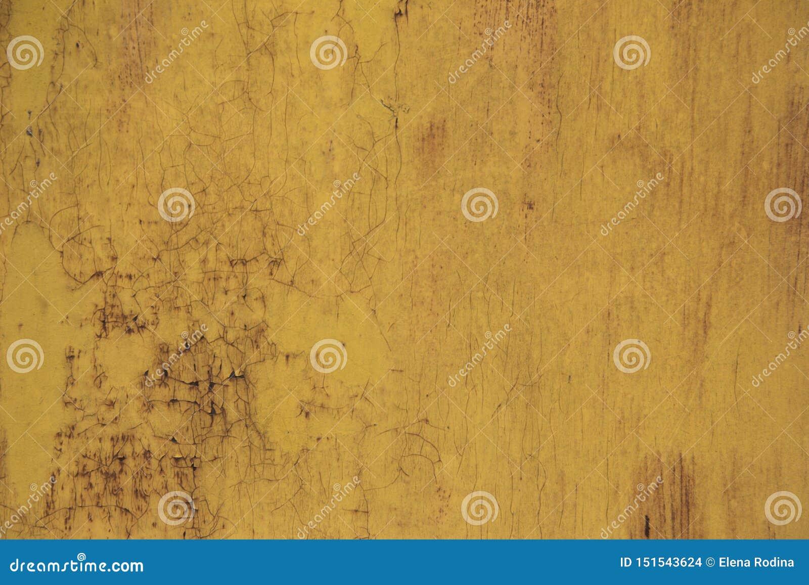 Roestig ijzer als achtergrond met resten van gekleurde verf Oranje Achtergrond