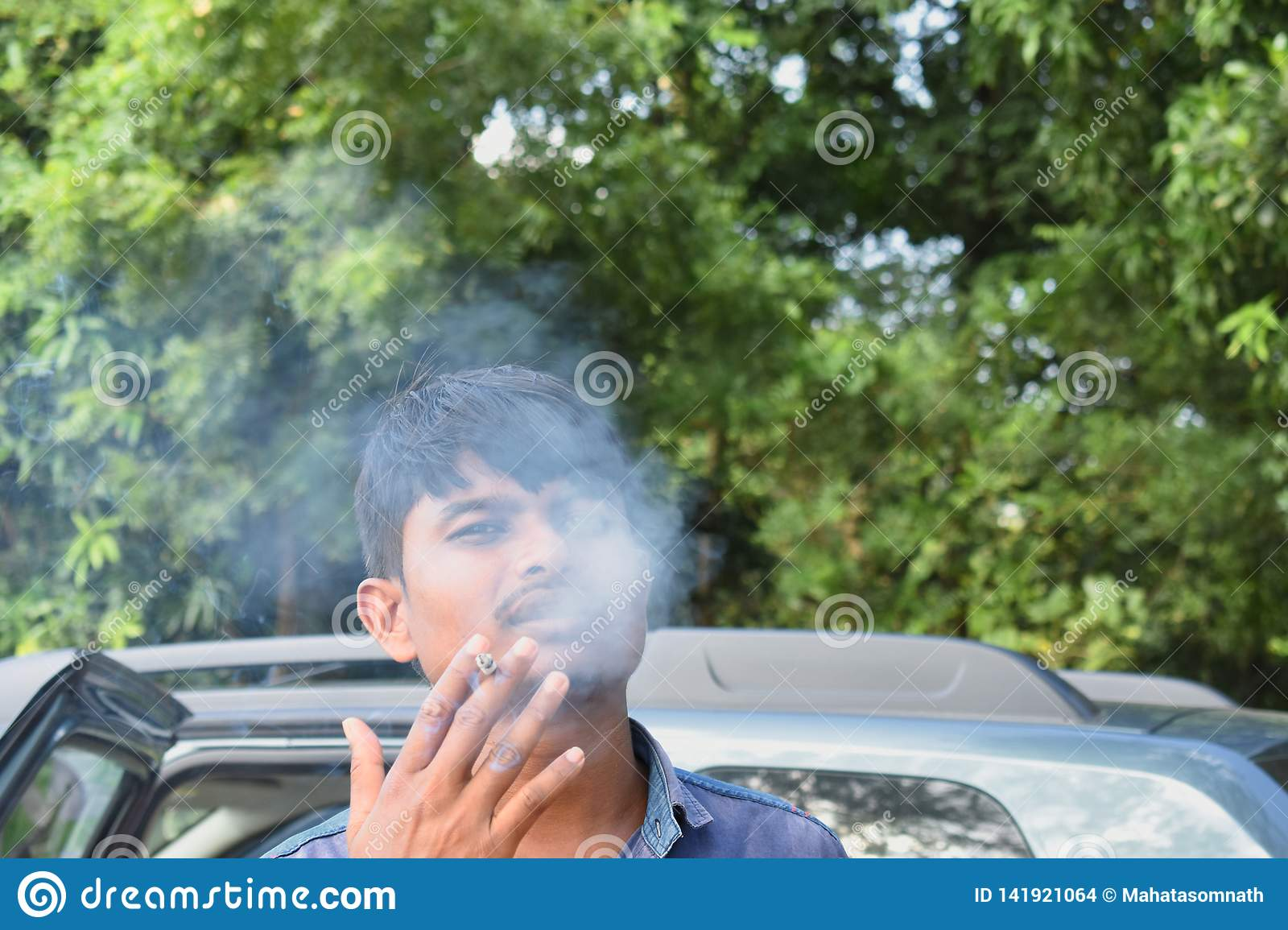 A man smoking with an attitude