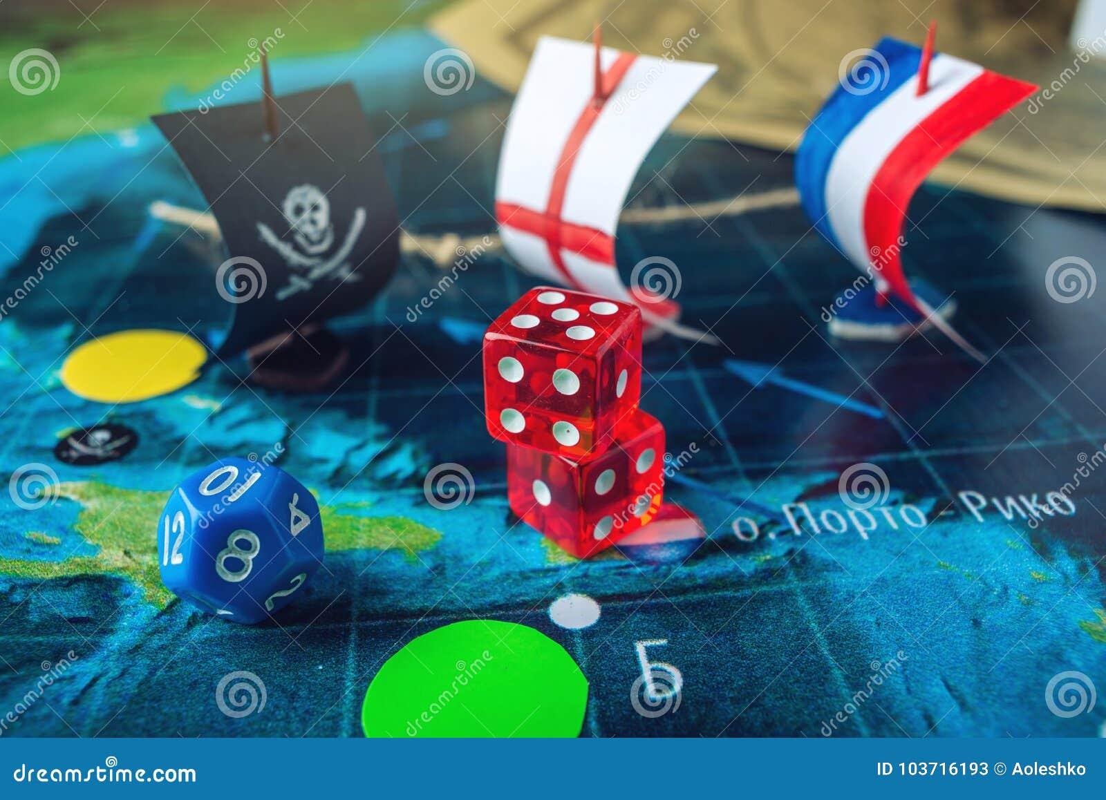 Rojo Que Juega Los Huesos En El Mapa Del Mundo De Los Juegos De Mesa