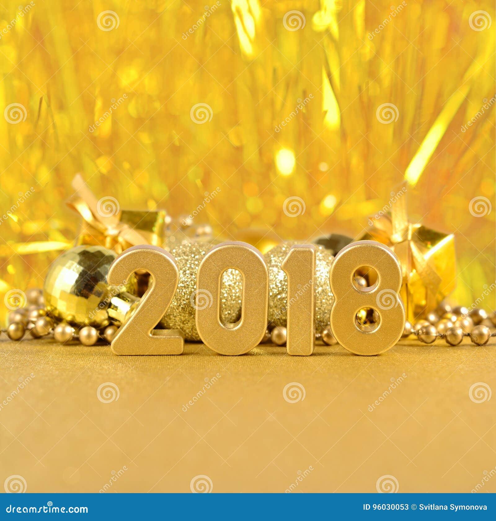 2018 rok złote postacie na bokeh tle