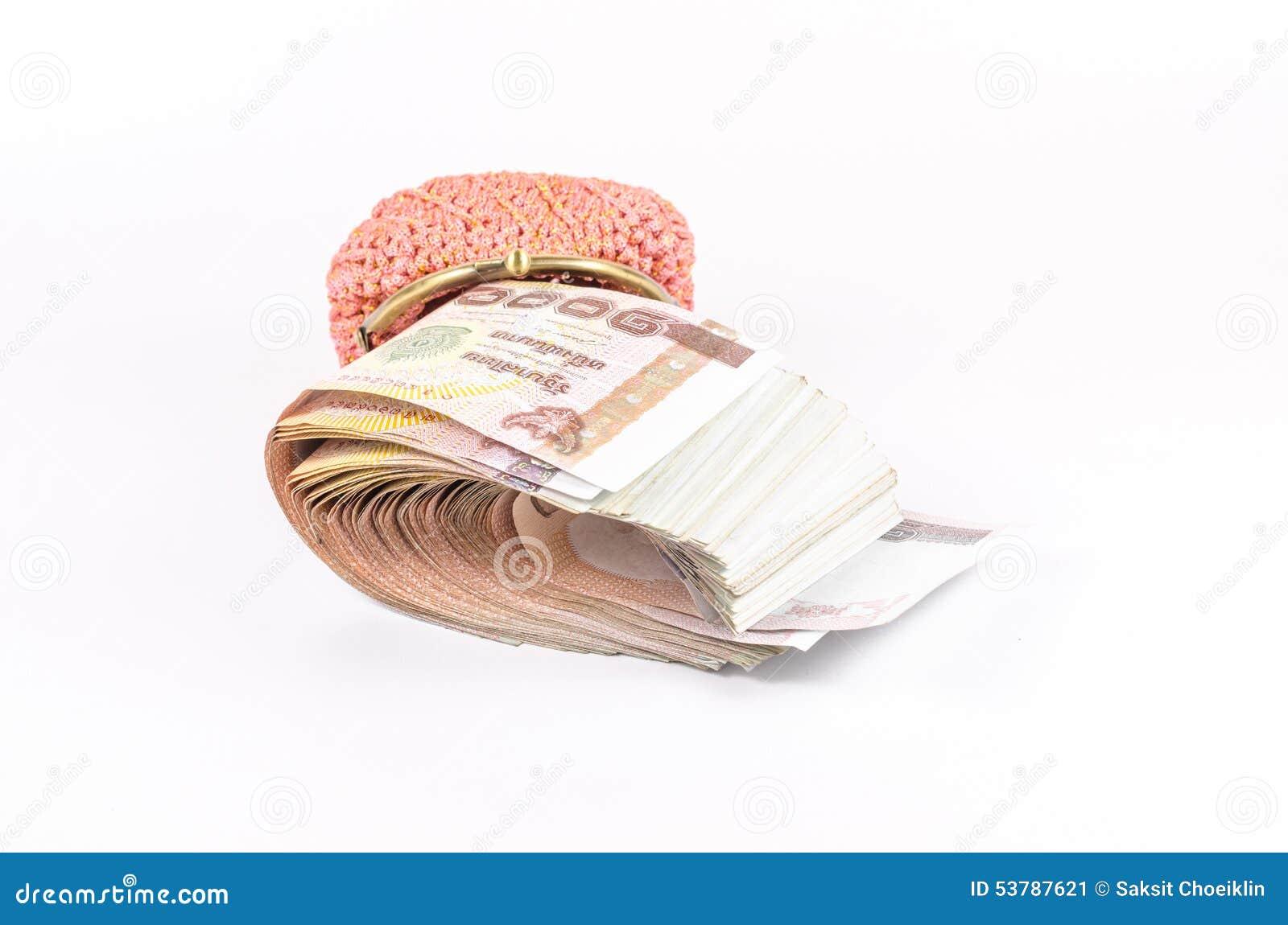 Rolka tajlandzki banknot w portflu odizolowywającym na białym tle