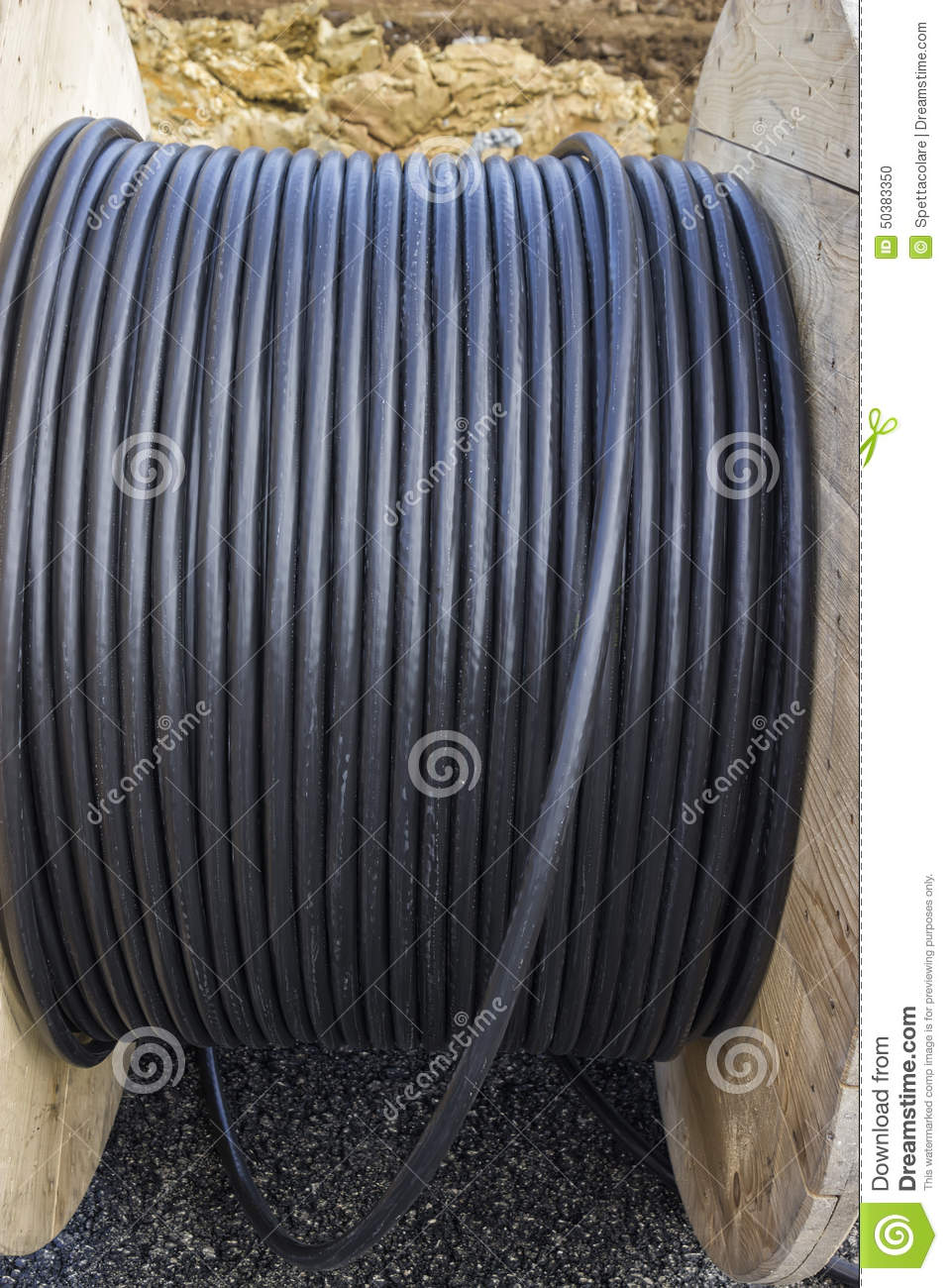 Roll Of Black Industrial Cable On Large Wooden Reel Stock