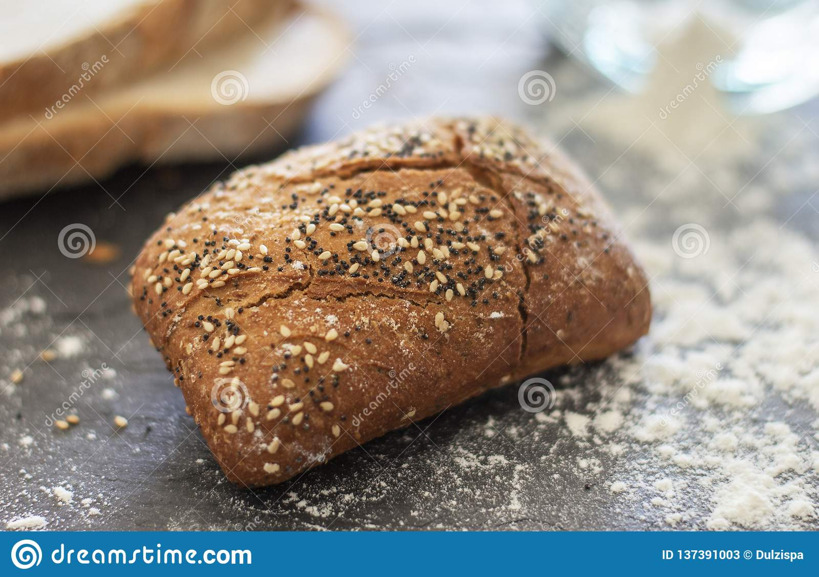 Roll bread with sesame and poppy seeds