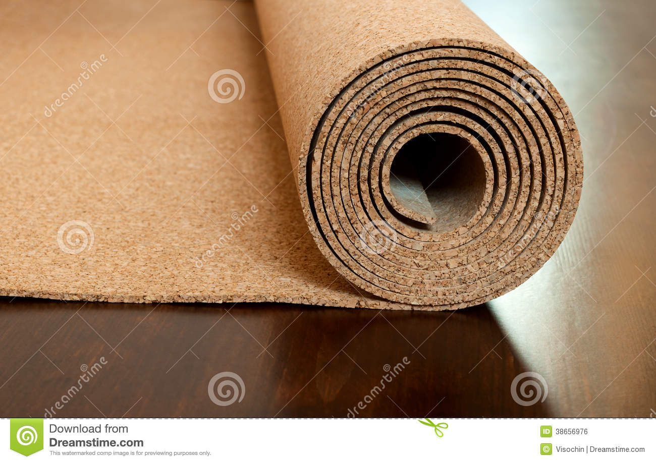 Roll Of Cork Lies On A Brown Floor Stock Photo - Image of cover