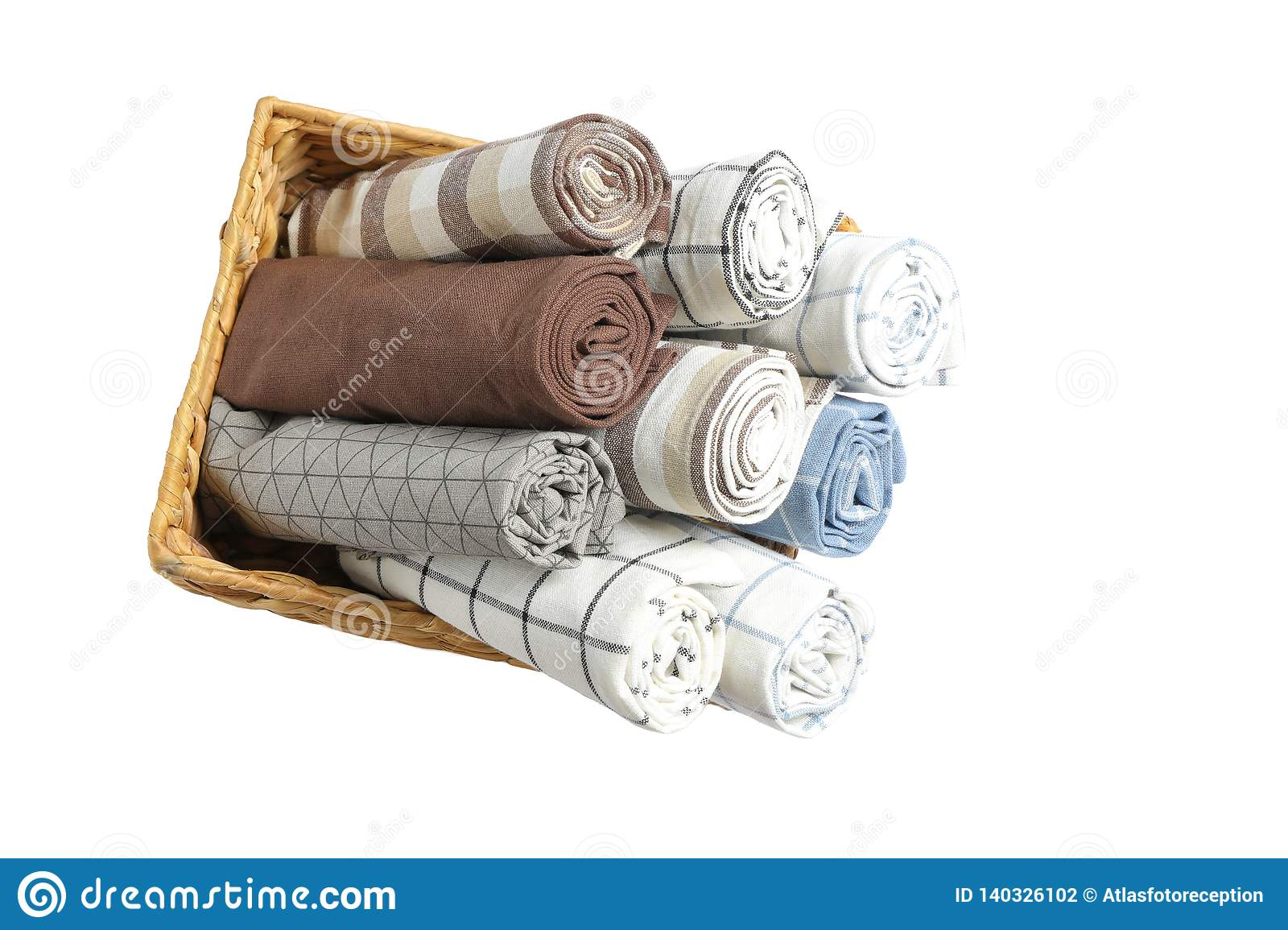 Rolled up fabric napkins in basket isolated