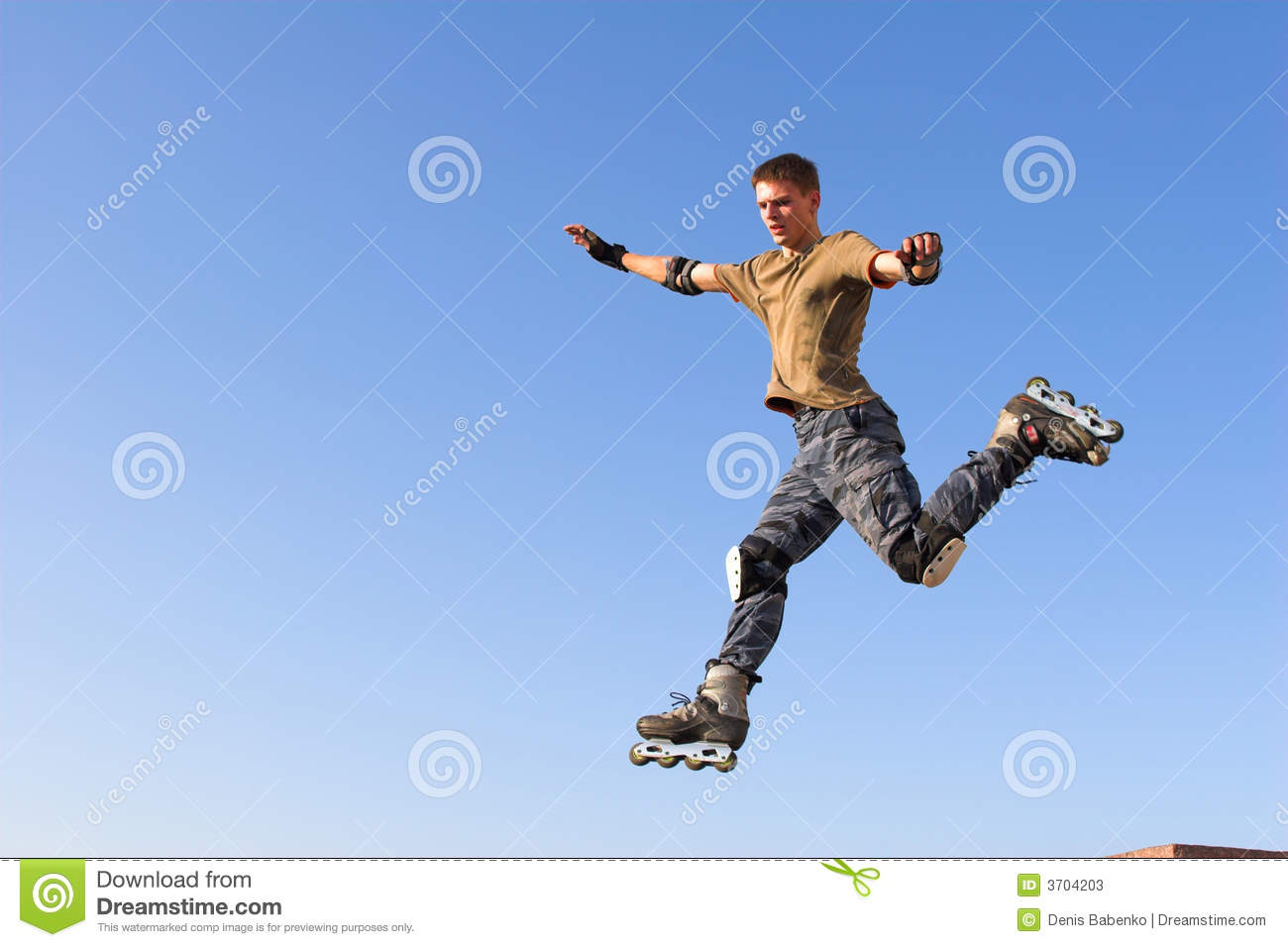 Roller boy jumping from parapet on the blue sky