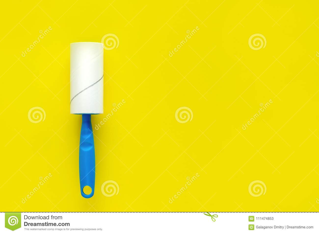 Roller Clothing Cleaner With Adhesive Tape And Blue Handle On A Yellow Background
