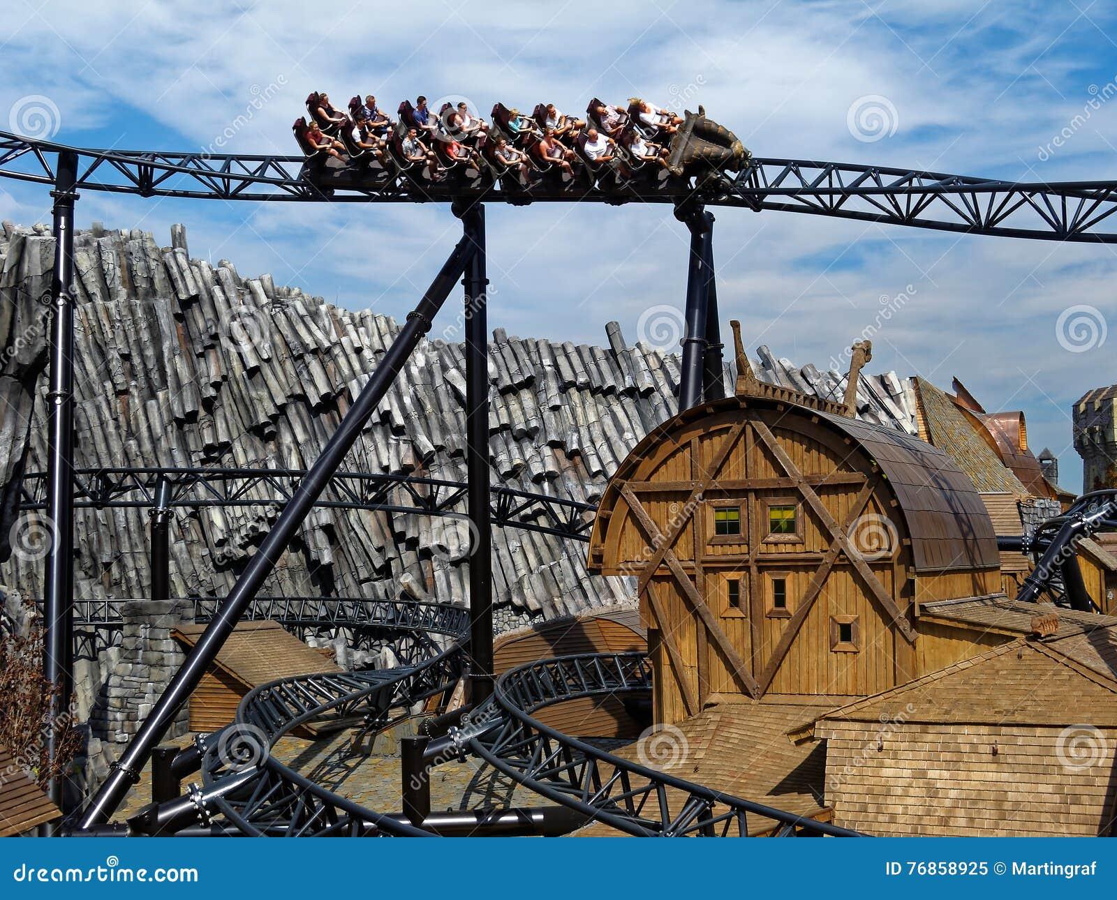 Roller coaster ride Taron in themed world Klugheim