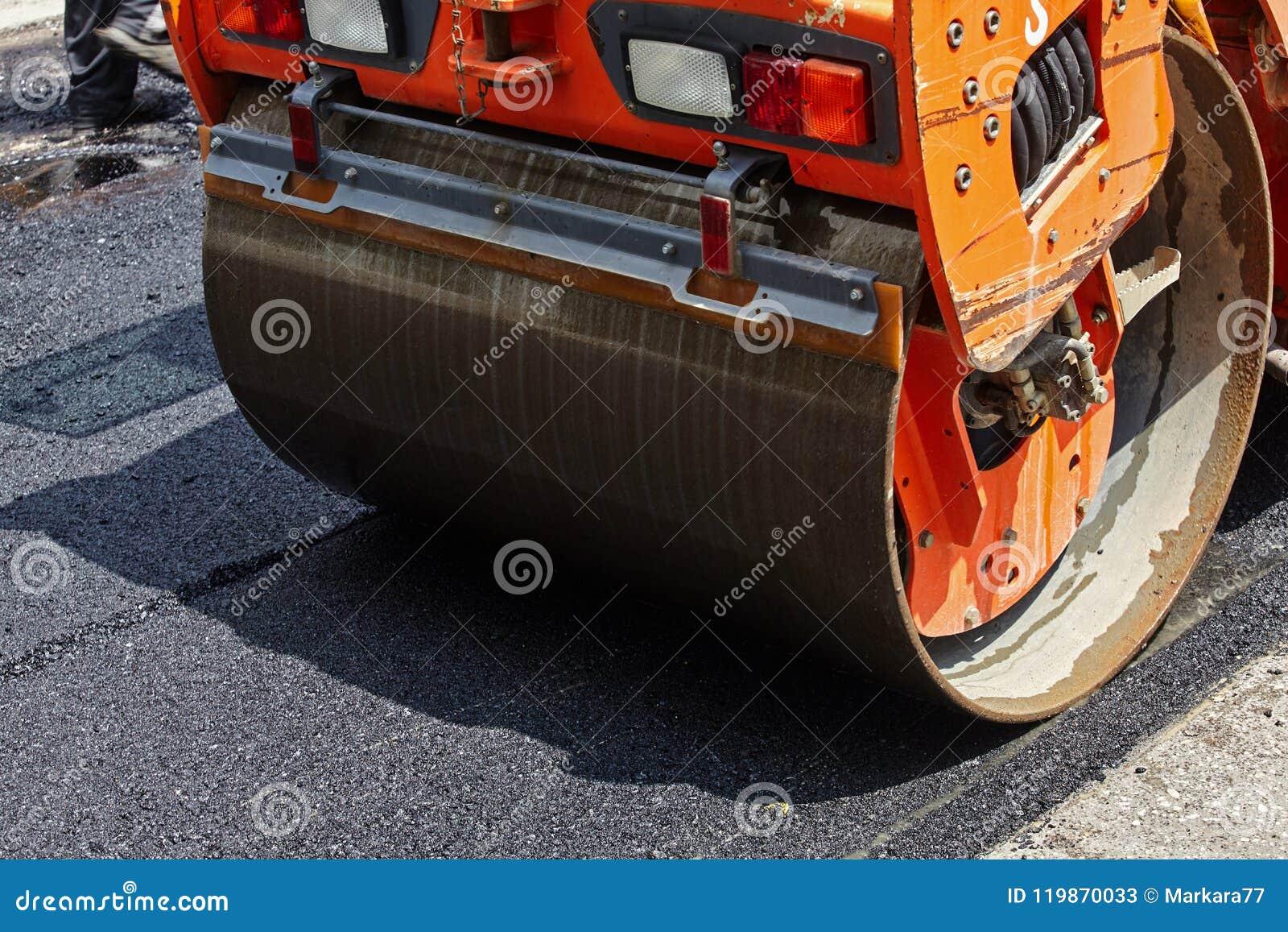 Roller Machine Working On The Asphalt Road Construction