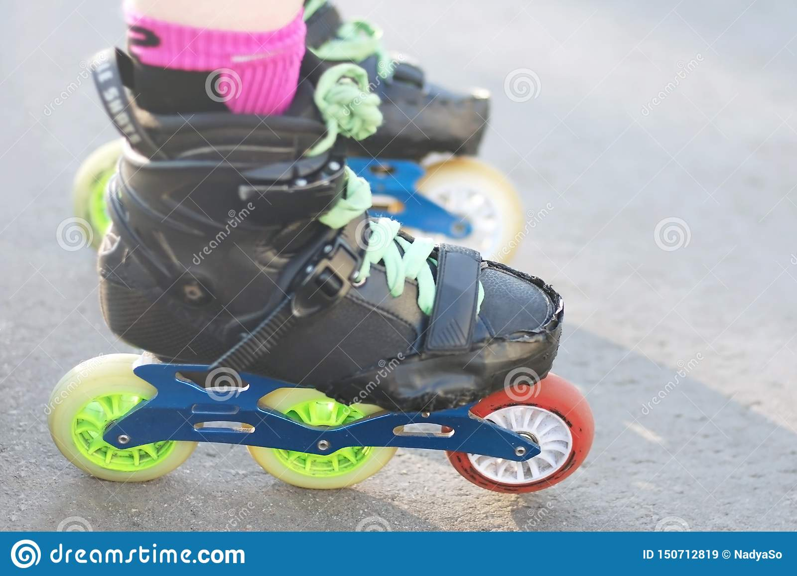 Roller`s legs wearing rollers for inline and slalom skating
