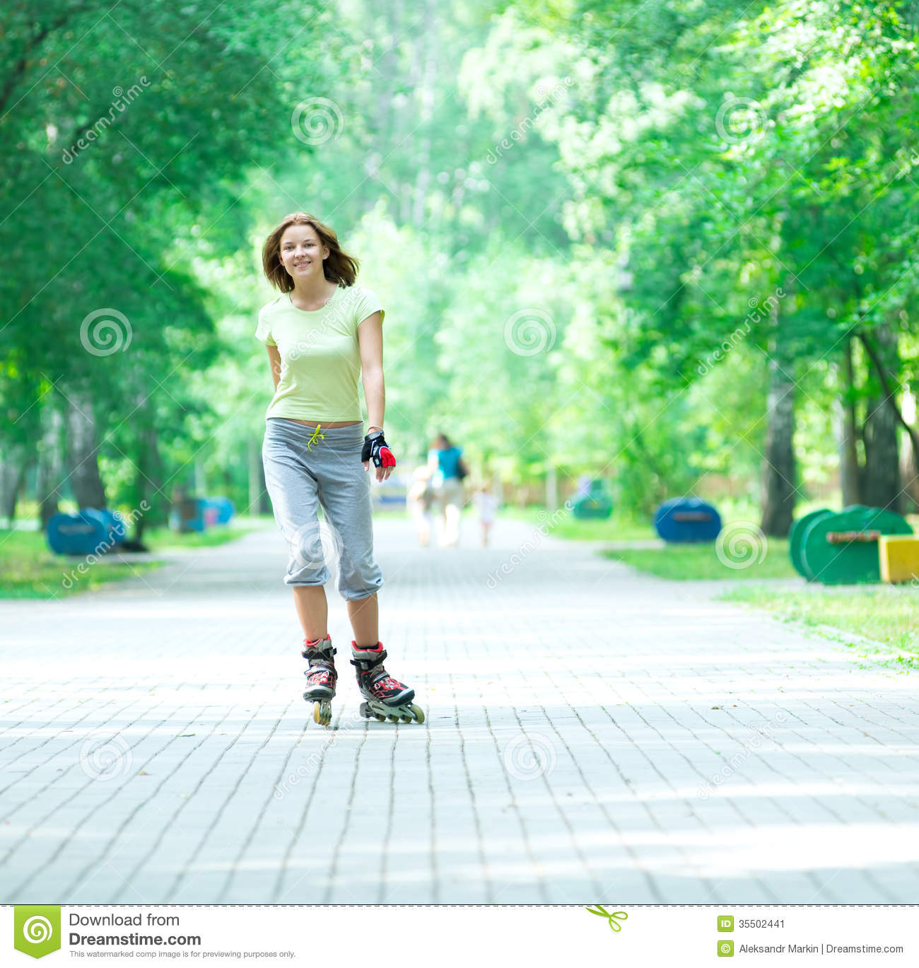 roller skating sporty girl in park rollerblading on inline