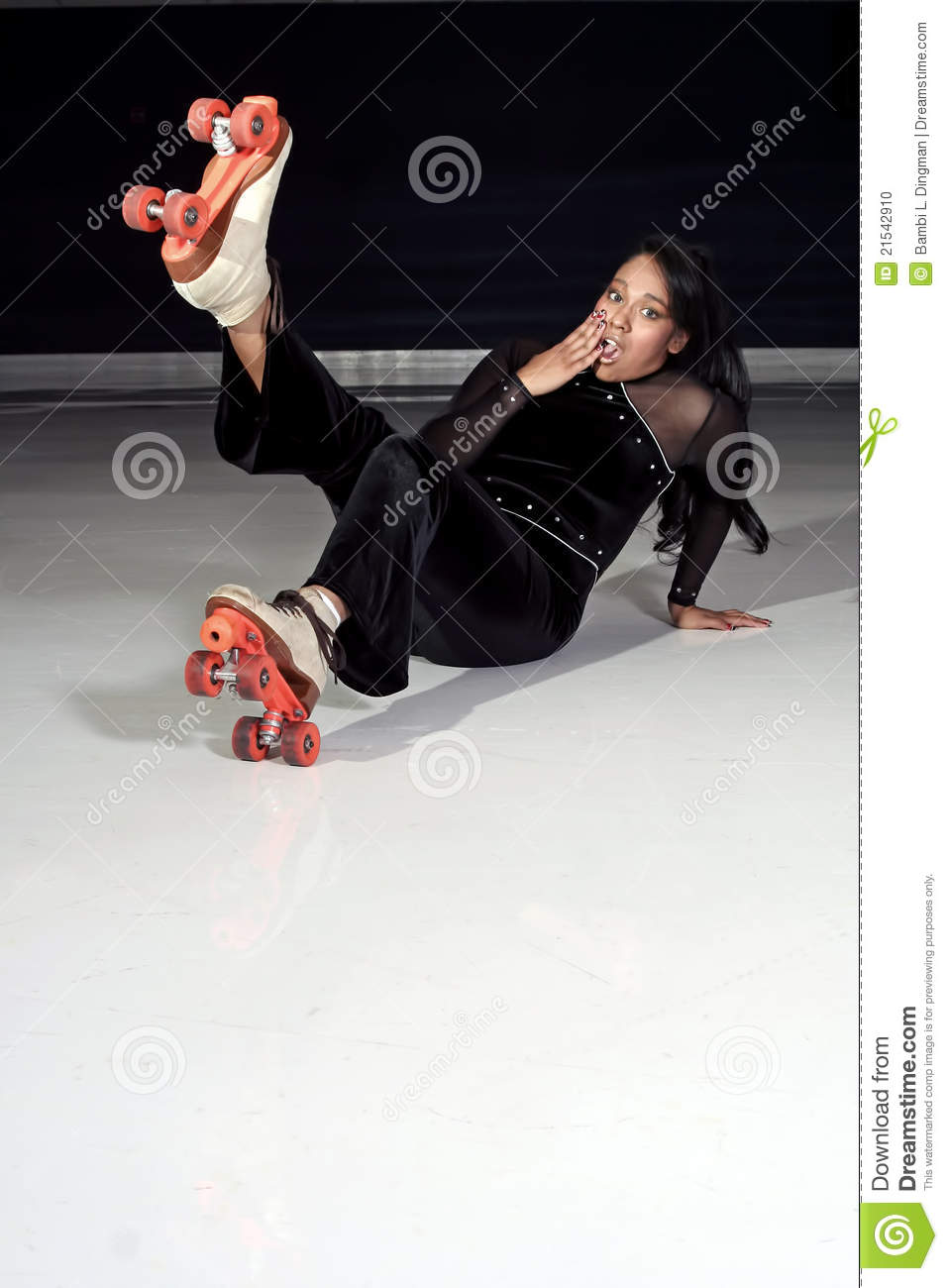 roller skating girl slips and falls on the rink.
