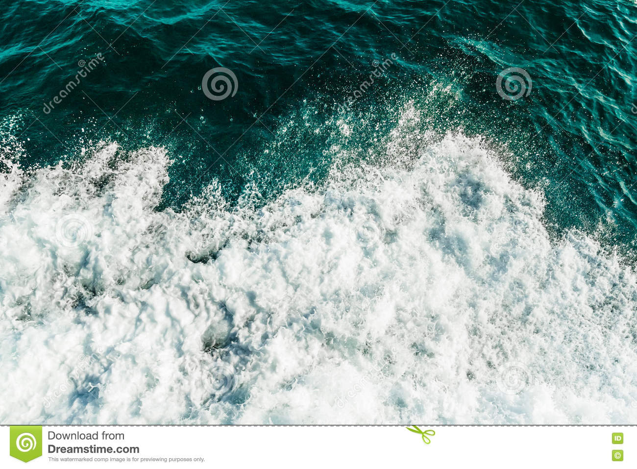 Rolling sea waves, top view of ocean covered by foam. Turquoise and green color water