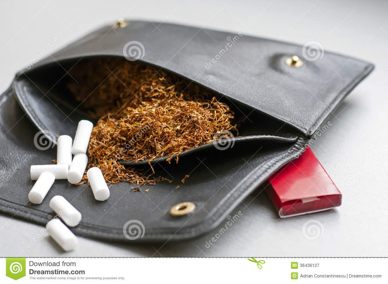 Rolling Tobacco In A Leather Pouch With Rollin Paper Box