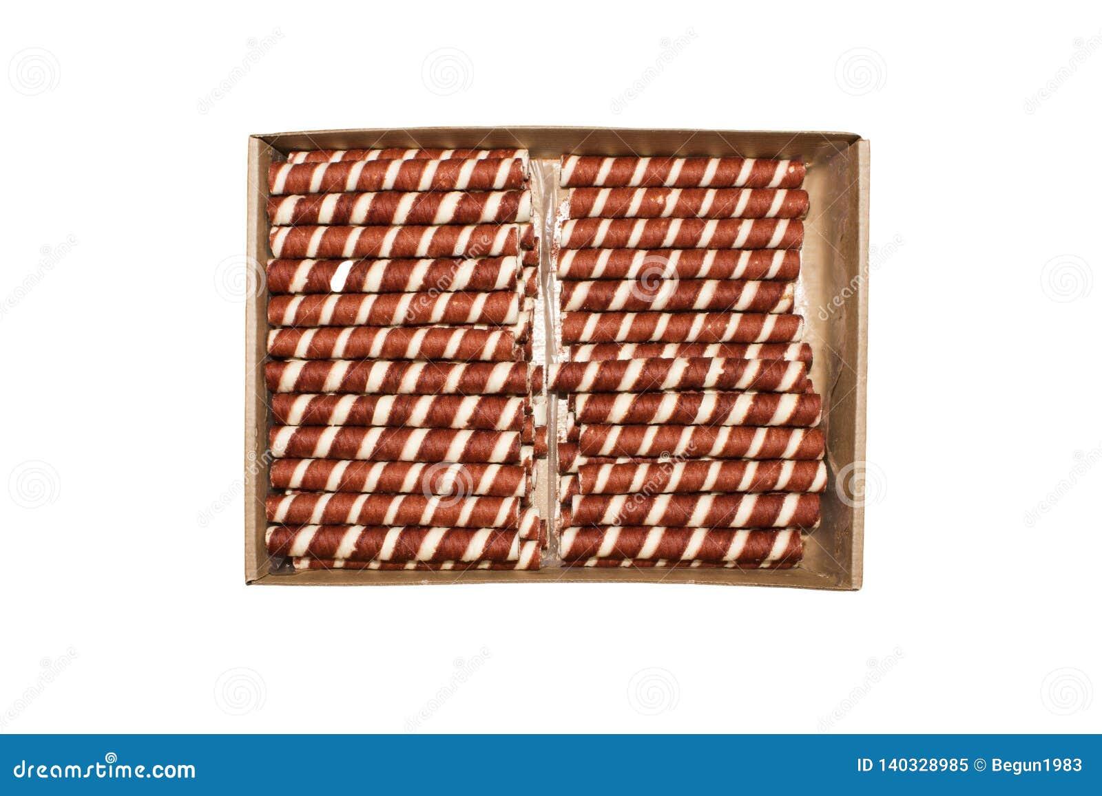 Rollos de la oblea con el relleno del chocolate