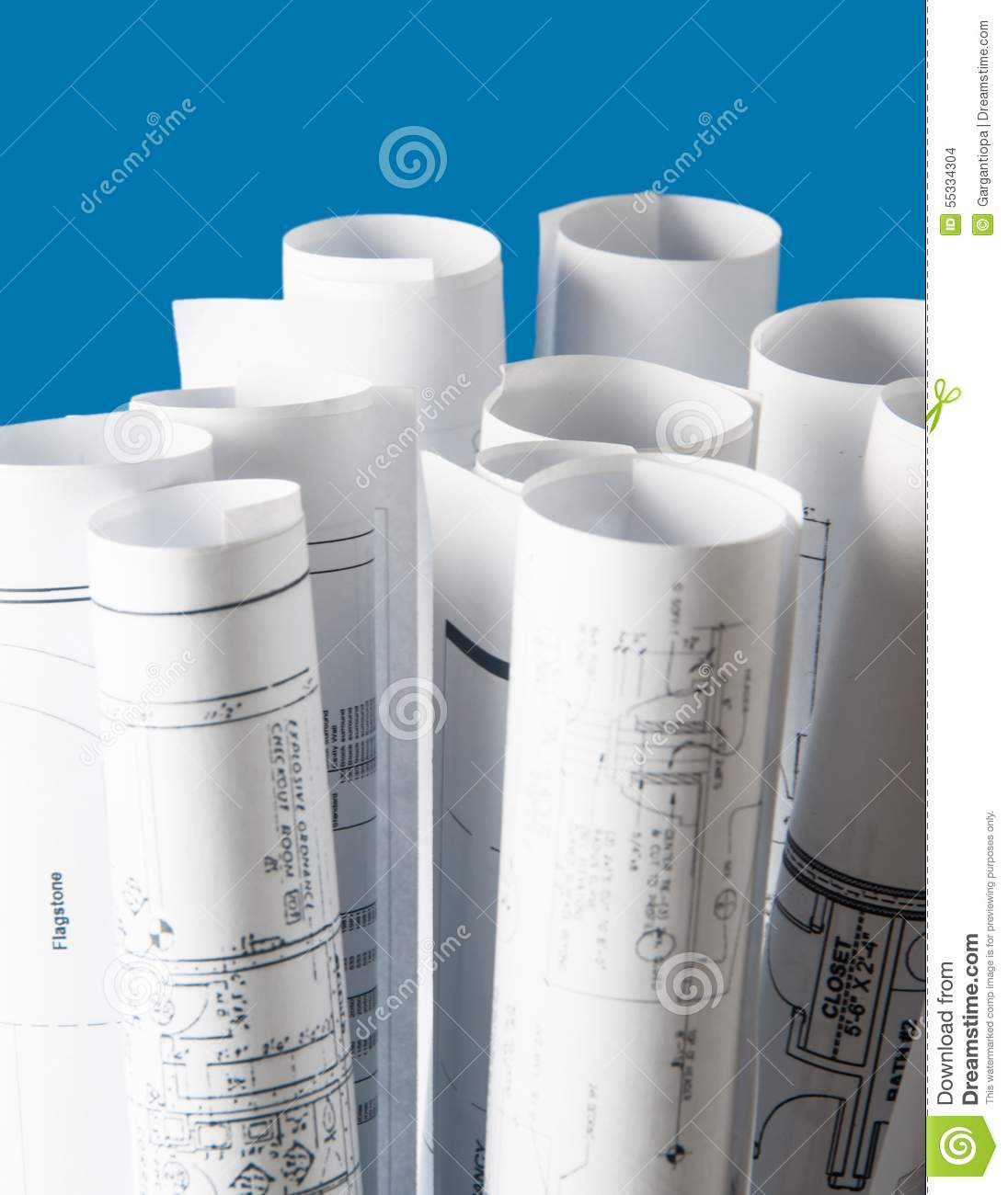 rolls of architecture blueprints and house plans stock photo architecture