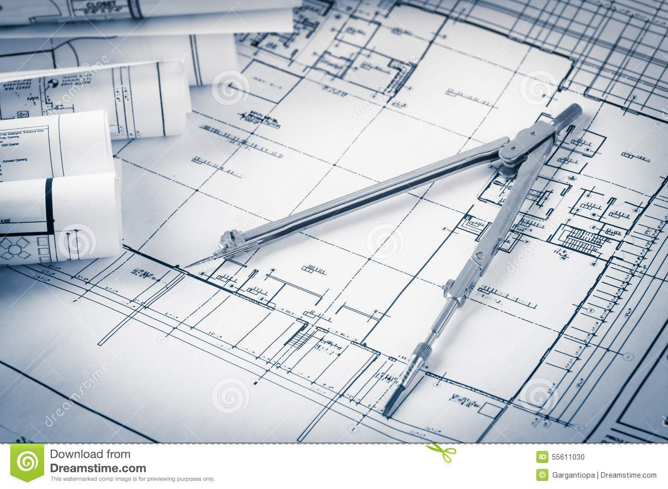 Architecture Blueprints House rolls of architecture blueprints and house plans stock photo