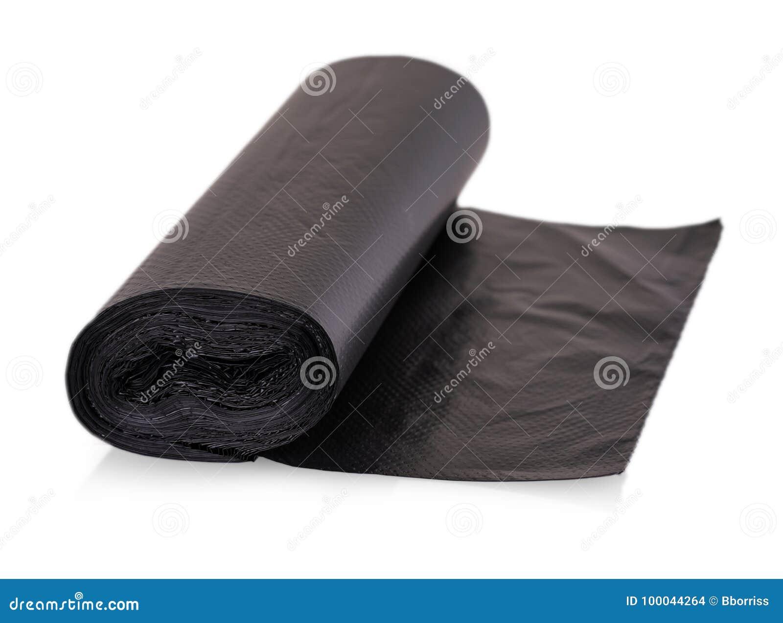 Rolls des sacs de déchets jetables d isolement au-dessus du fond blanc