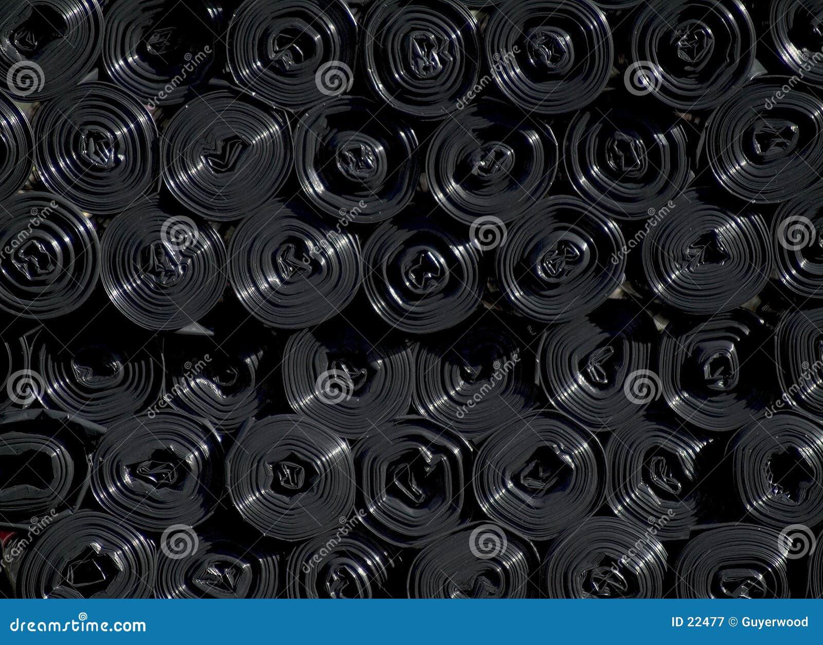 Rolls des sacs en plastique noirs