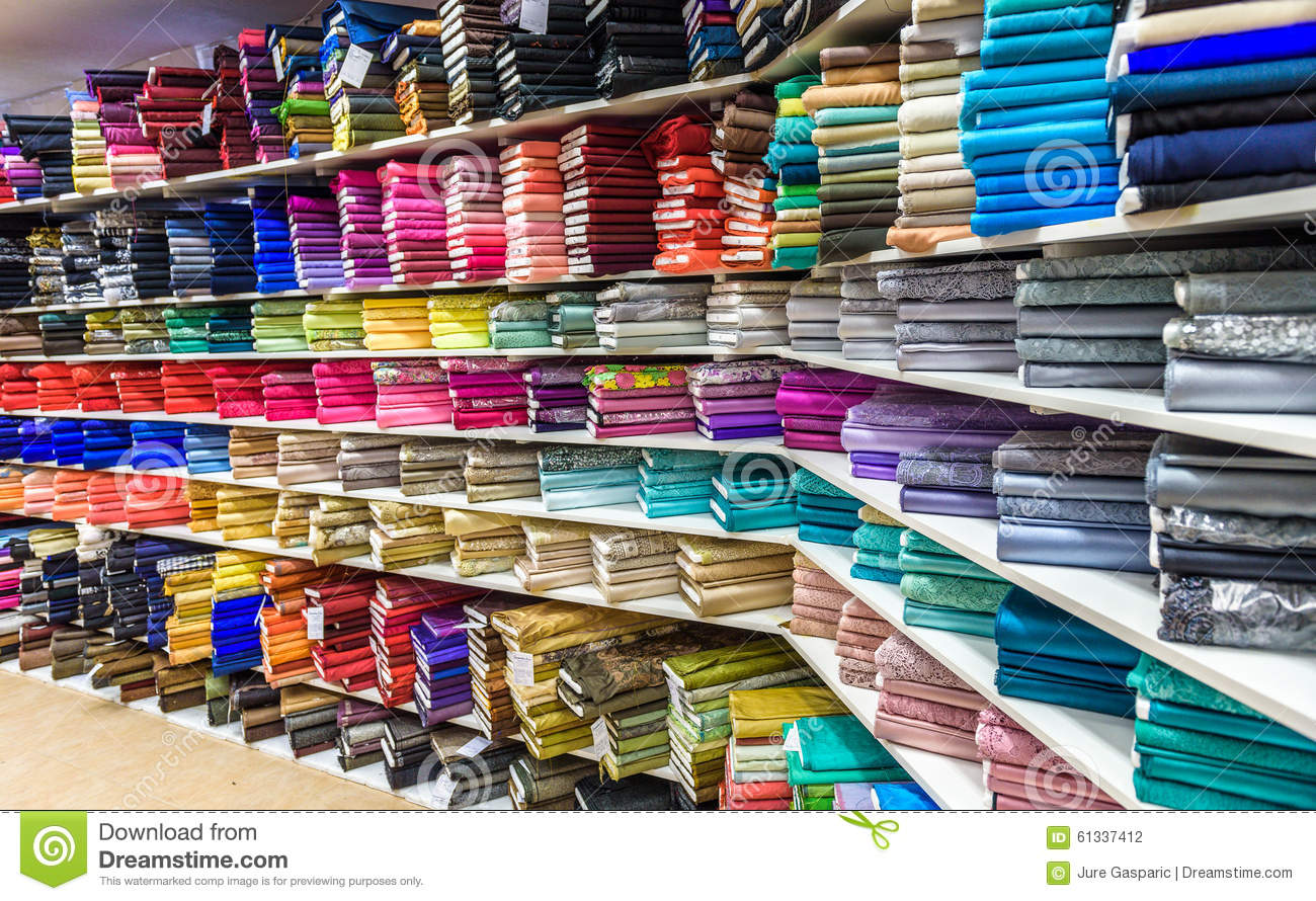 Rolls of fabric and textiles in a factory shop or store for Designer fabric store
